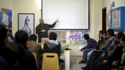 An adviser from Microsoft provides guidance to young Palestinian entrepreneurs at Gaza Sky Geeks office, in Gaza City January 21, 2016. Picture taken January 21, 2016.