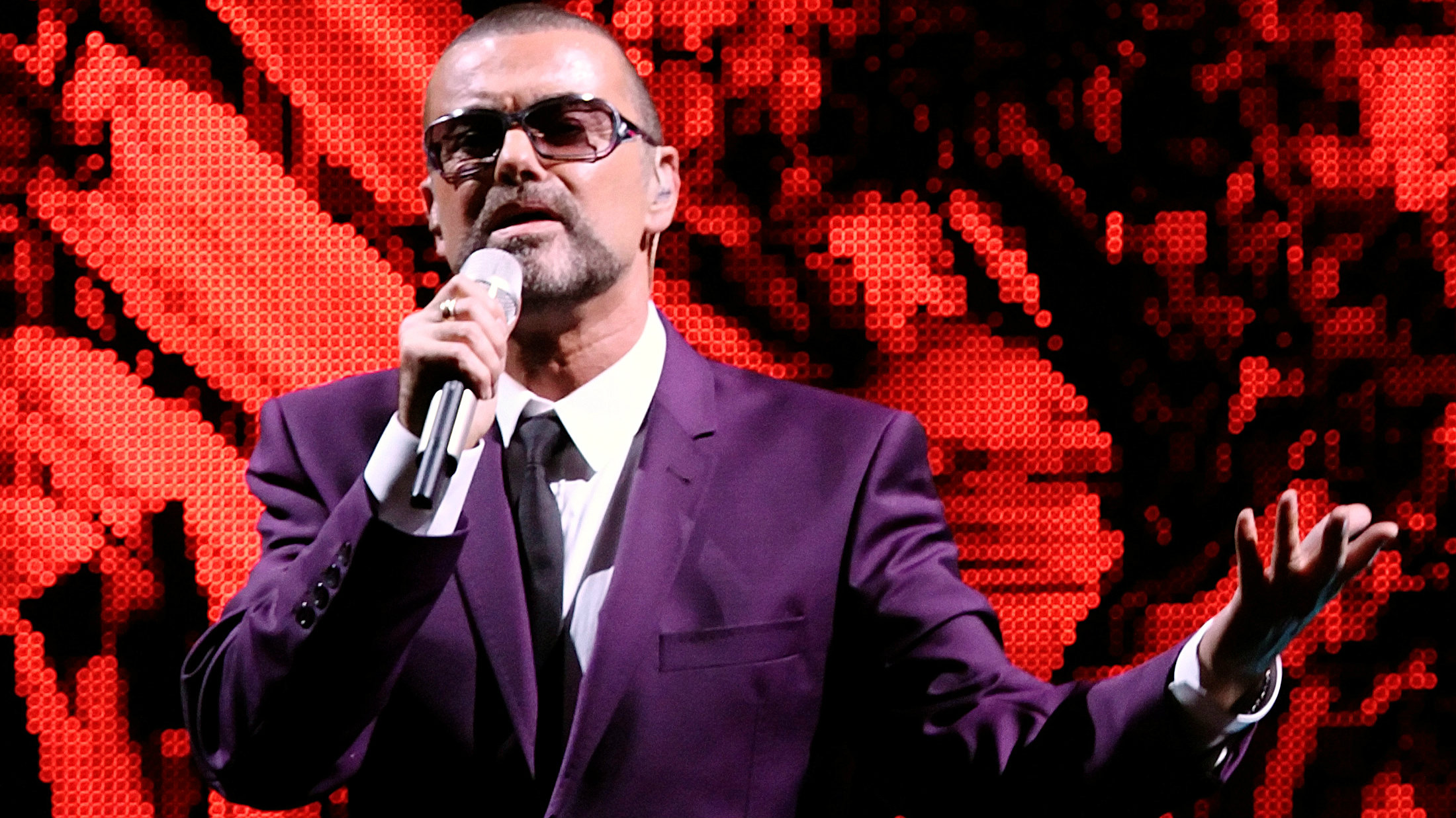 """British singer George Michael performs on stage during his """"Symphonica"""" tour concert in Vienna September 4, 2012"""