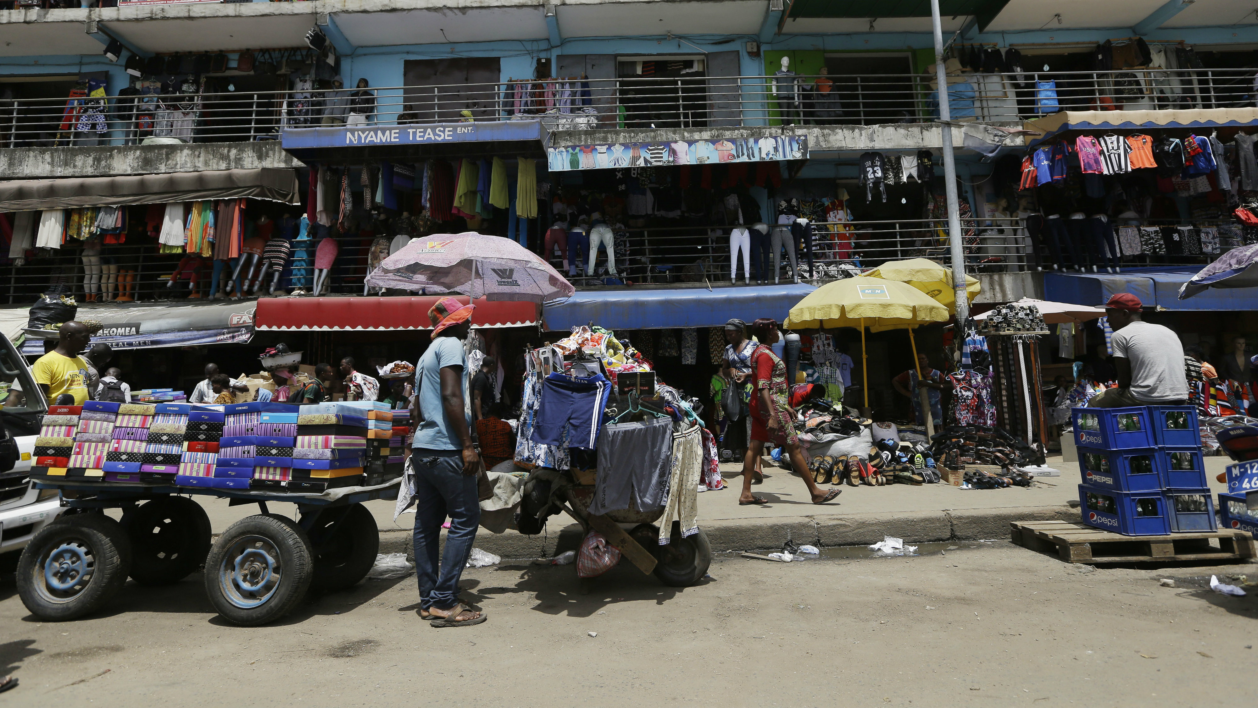 People shop at a central Market in Accra, Ghana, Saturday, June 6, 2015.