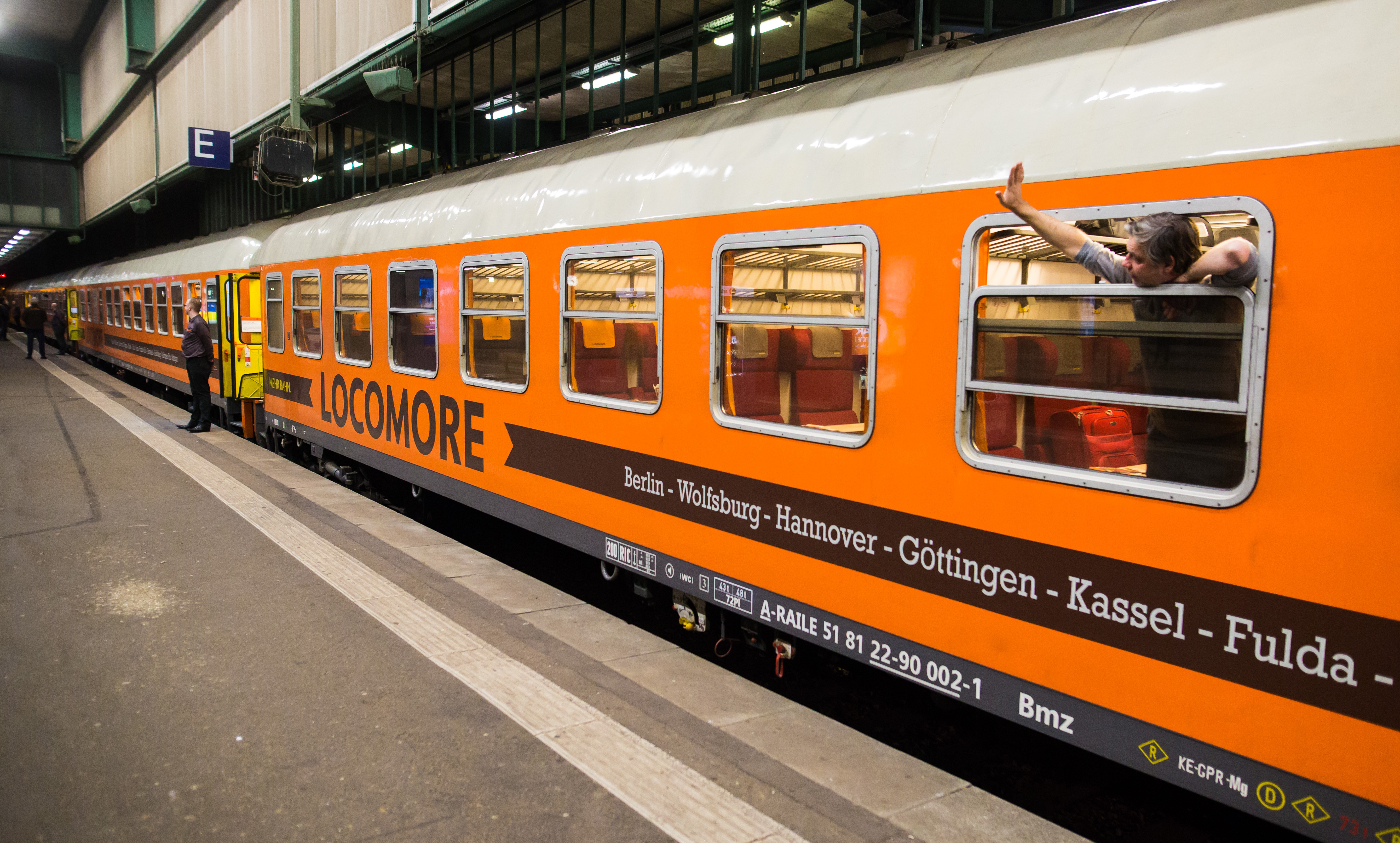 A passenger waves from a window of a train of the crowdfunded company 'Locomore', at the station in Stuttgart, Germany, 14 December 2016. German company 'Locomore' on 13 December 2016 had its trains running for the first time on the route between Stuttgart and the German capital Berlin.