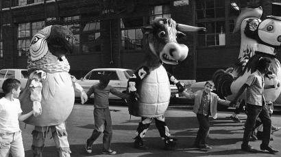 """Chicago school children walk hand-in-hand with costumed animals made of papier-mache in Chicago, Sept. 13, 1967 during """"test day"""" for the paper characters. The animals will be part of a Christmas parade in Chicago on November 26. (AP Photo/Charles Knoblock)"""