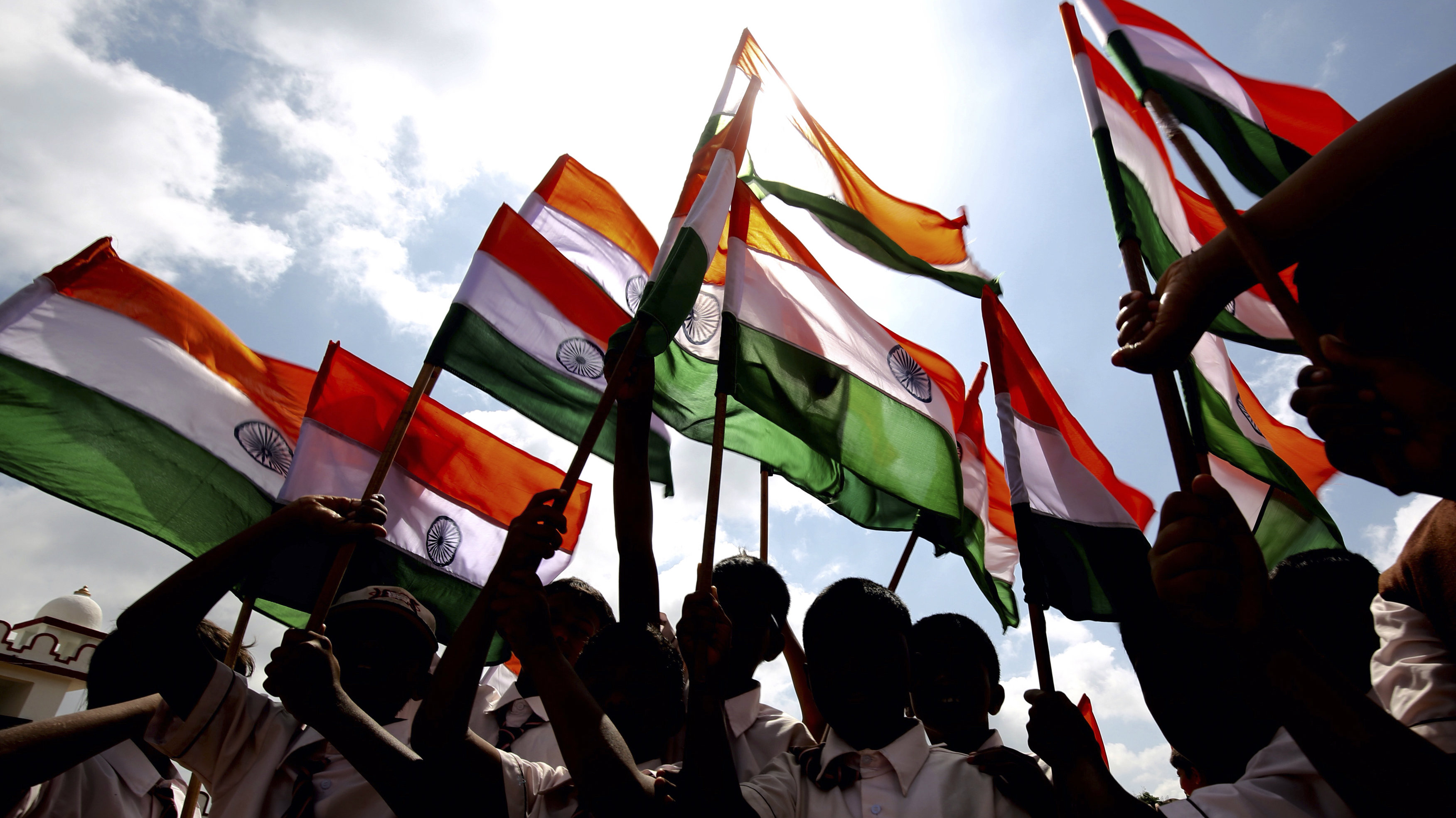 ndian school children hold the Indian national flag during rehearsal for India's Independence Day parade and celebrations in Bangalore, India, 13 August 2016. India's 70th Independence Day will be celebrated on 15 August, to commemorate its independence from British rule and its birth as a sovereign nation on that day in 1947.