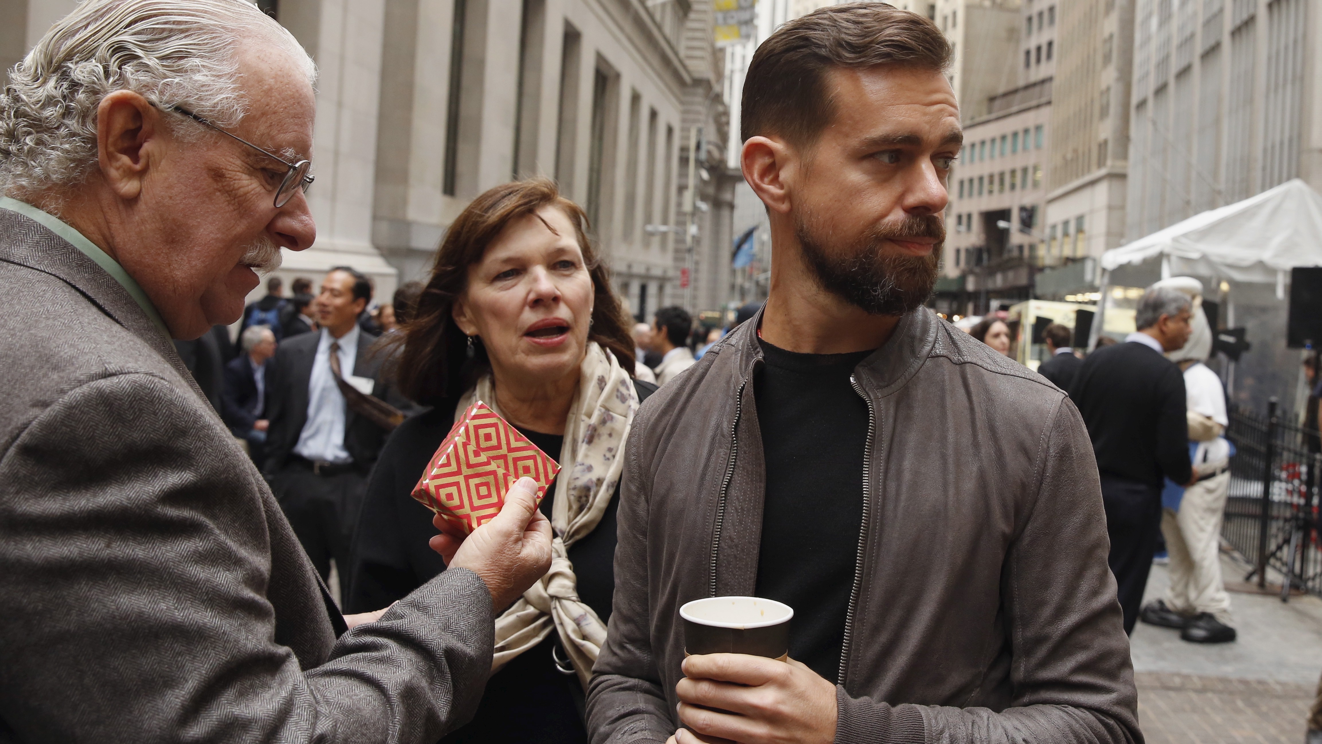 Jack Dorsey, CEO of Square and CEO of Twitter, stands with his parents Marcia and Tim Dorsey while waiting for an event outside of the New York Stock Exchange to celebrate the IPO of Square Inc., in New York November 19, 2015. Square Inc priced shares at $9 for its initial public offering, about 25 percent less than it had hoped, as it struggled to win over investors skeptical about its business and valuation before trading begins on Thursday.  REUTERS/Lucas Jackson - RTS7Z2L