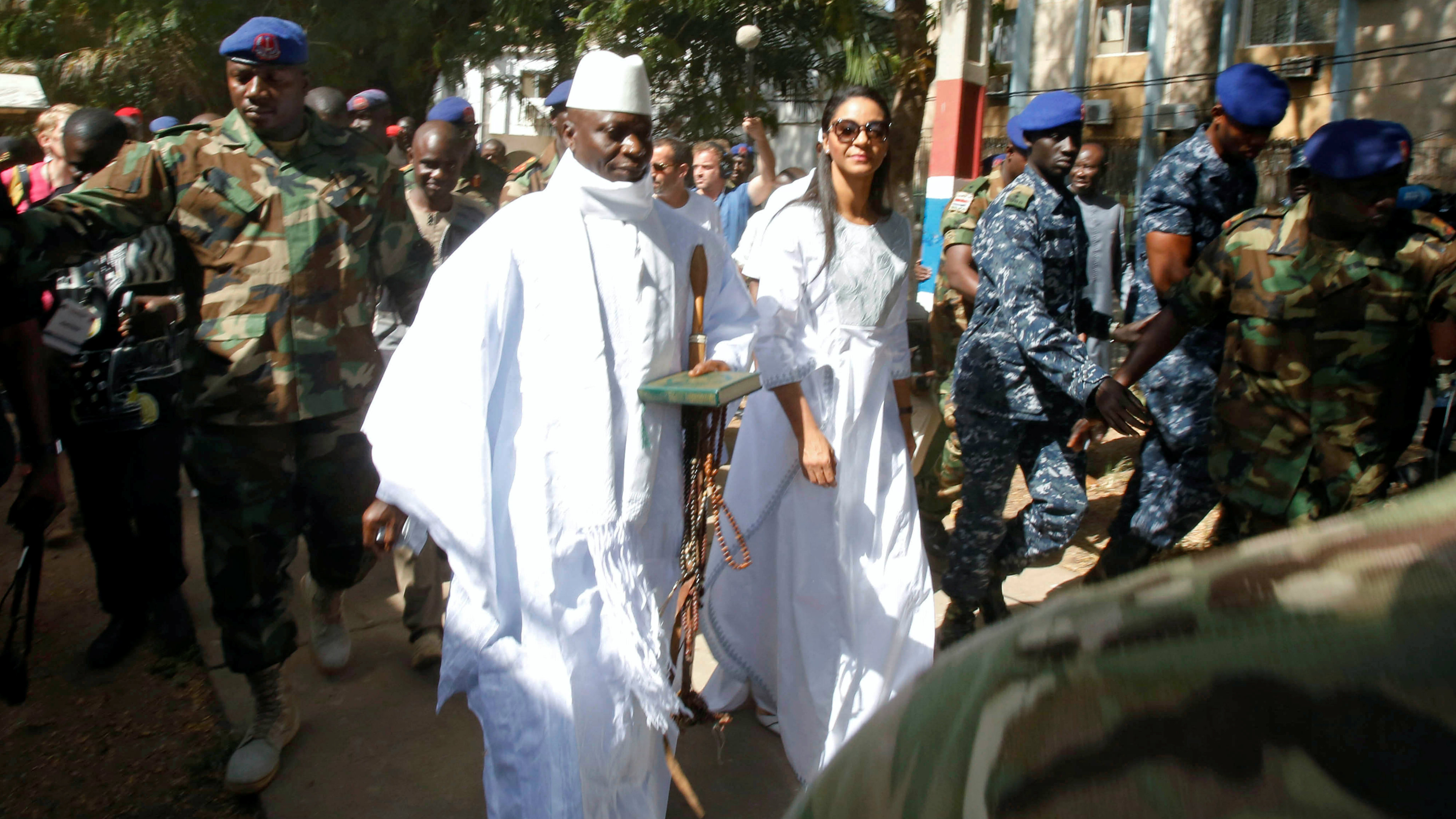 Gambian President Yahya Jammeh arrives at a polling station with his wife Zineb during the presidential election in Banjul, Gambia, December 1, 2016