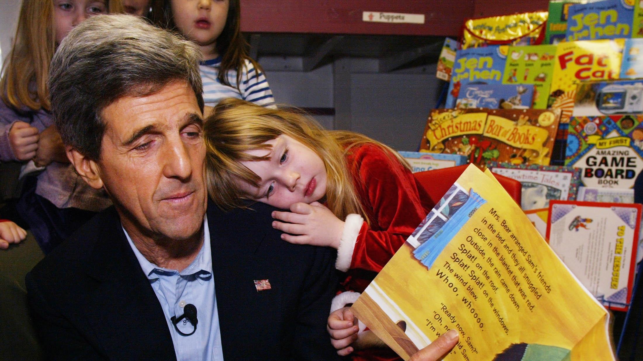 John Kerry reading a book to kids.
