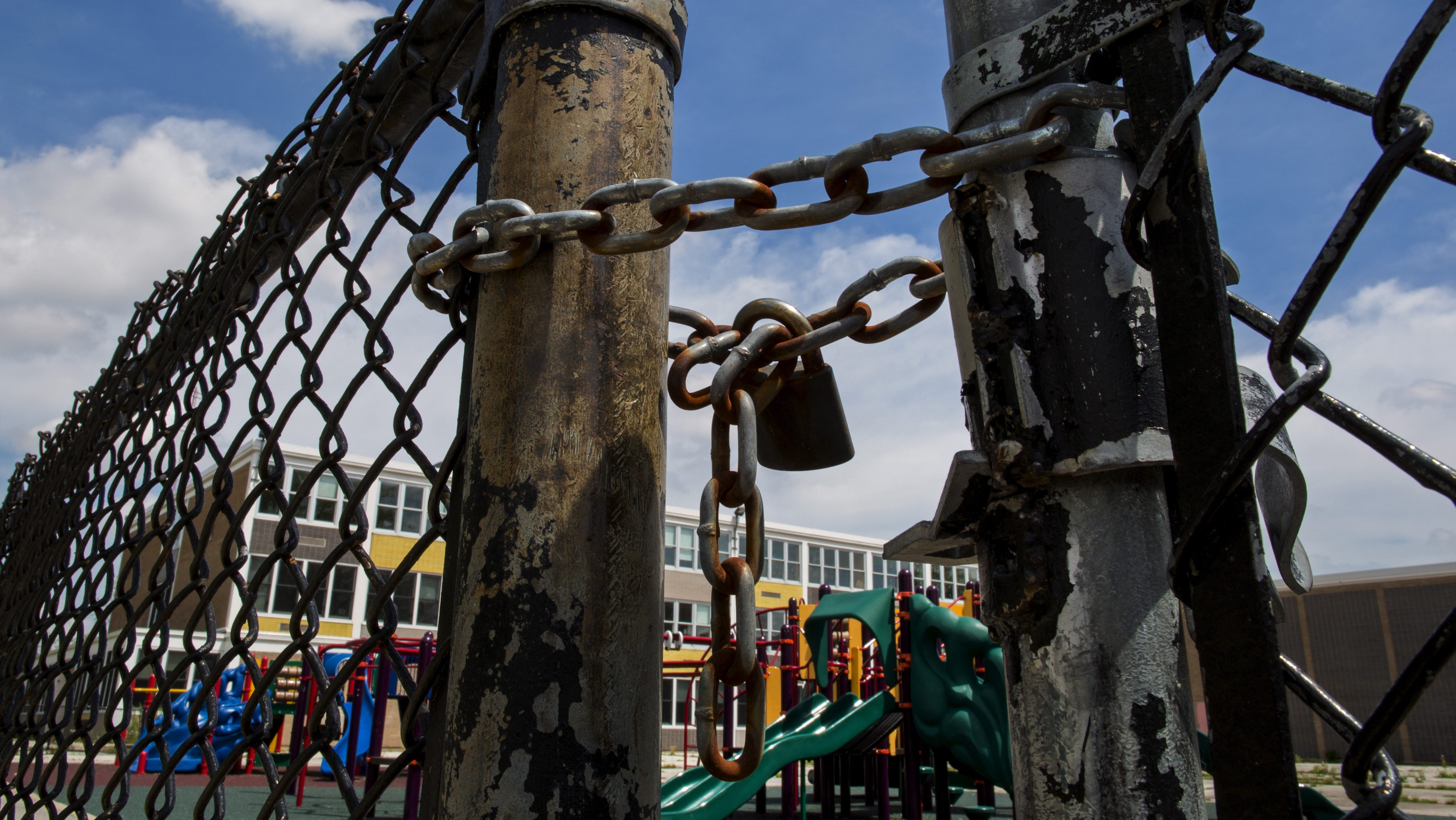 A playground is seen behind a locked gate at Woods Elementary Math & Science Academy in Chicago, Illinois, United States, May 8, 2015.