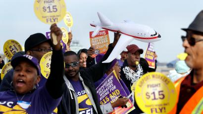 SEIU Local 1 union members protest for an increase in the minimum wage, Tuesday, Nov. 29, 2016, at the Detroit Metropolitan Airport in Romulus, Mich. Fast-food restaurant and airport workers, as well as home and child-care workers rallied in cities including Chicago, Detroit, Houston, Los Angeles, Minneapolis and New York on Tuesday morning. In many cities the protesters blocked busy intersections.