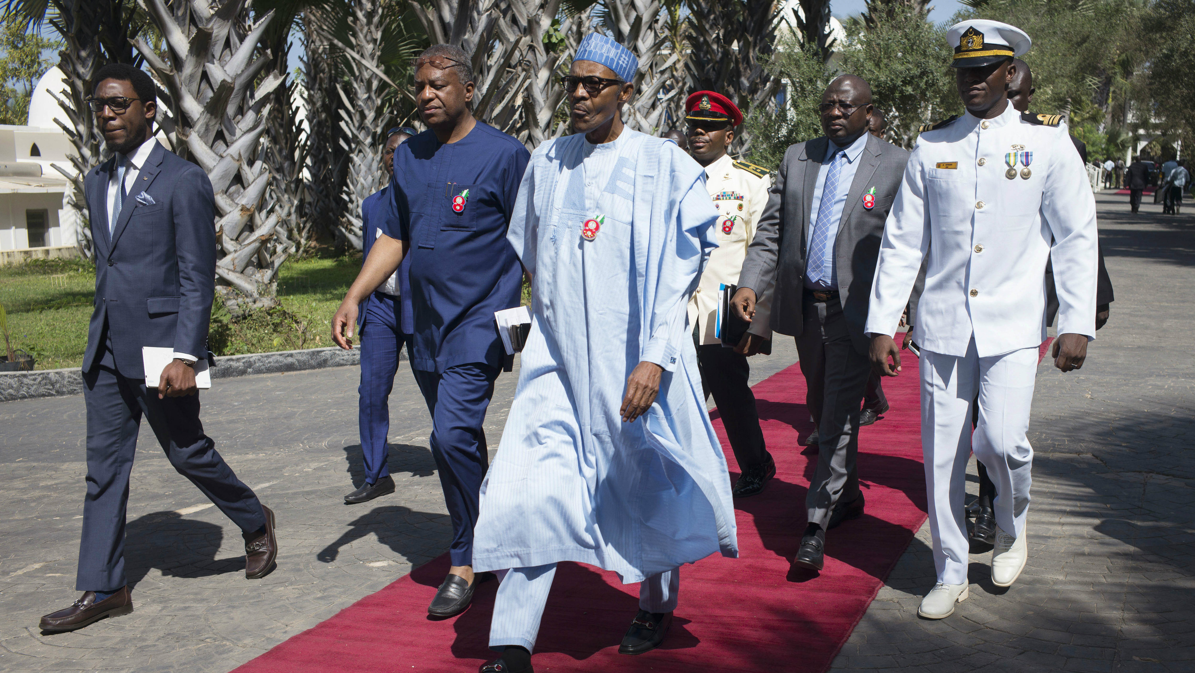 Nigeria President, Muhammadu Buhari, centre, on arrival for talks with Gambia's President Yahya Jammeh, in Banjul, Gambia, Tuesday, Dec. 13, 2016