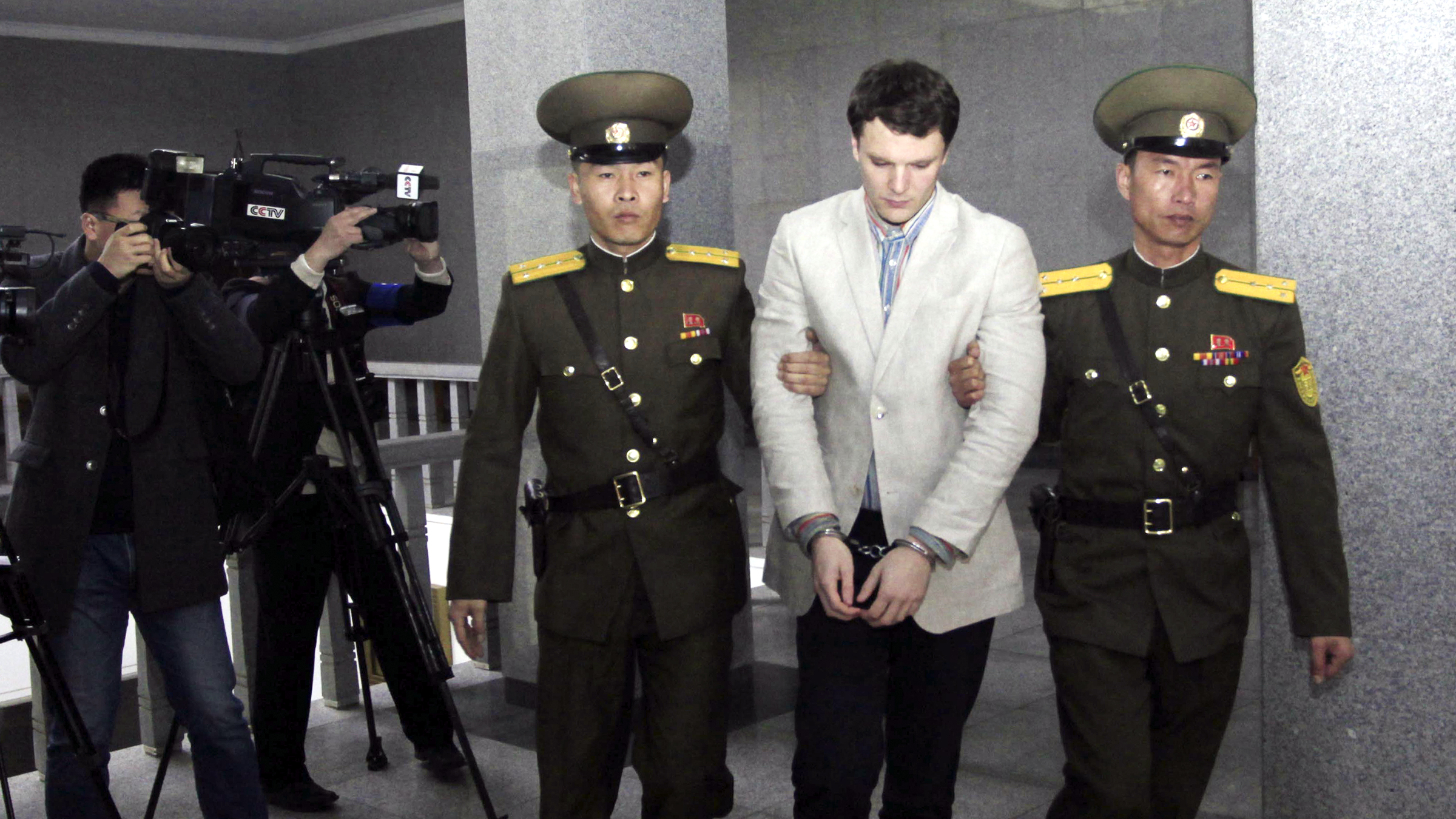 American student Otto Warmbier, center, is escorted at the Supreme Court, Wednesday, March 16, 2016, in Pyongyang, North Korea. North Korea's highest court sentenced Warmbier, a 21-year-old University of Virginia undergraduate student, from Wyoming, Ohio, to 15 years in prison with hard labor on Wednesday for subversion. He allegedly attempted to steal a propaganda banner from a restricted area of his hotel at the request of an acquaintance who wanted to hang it in her church.