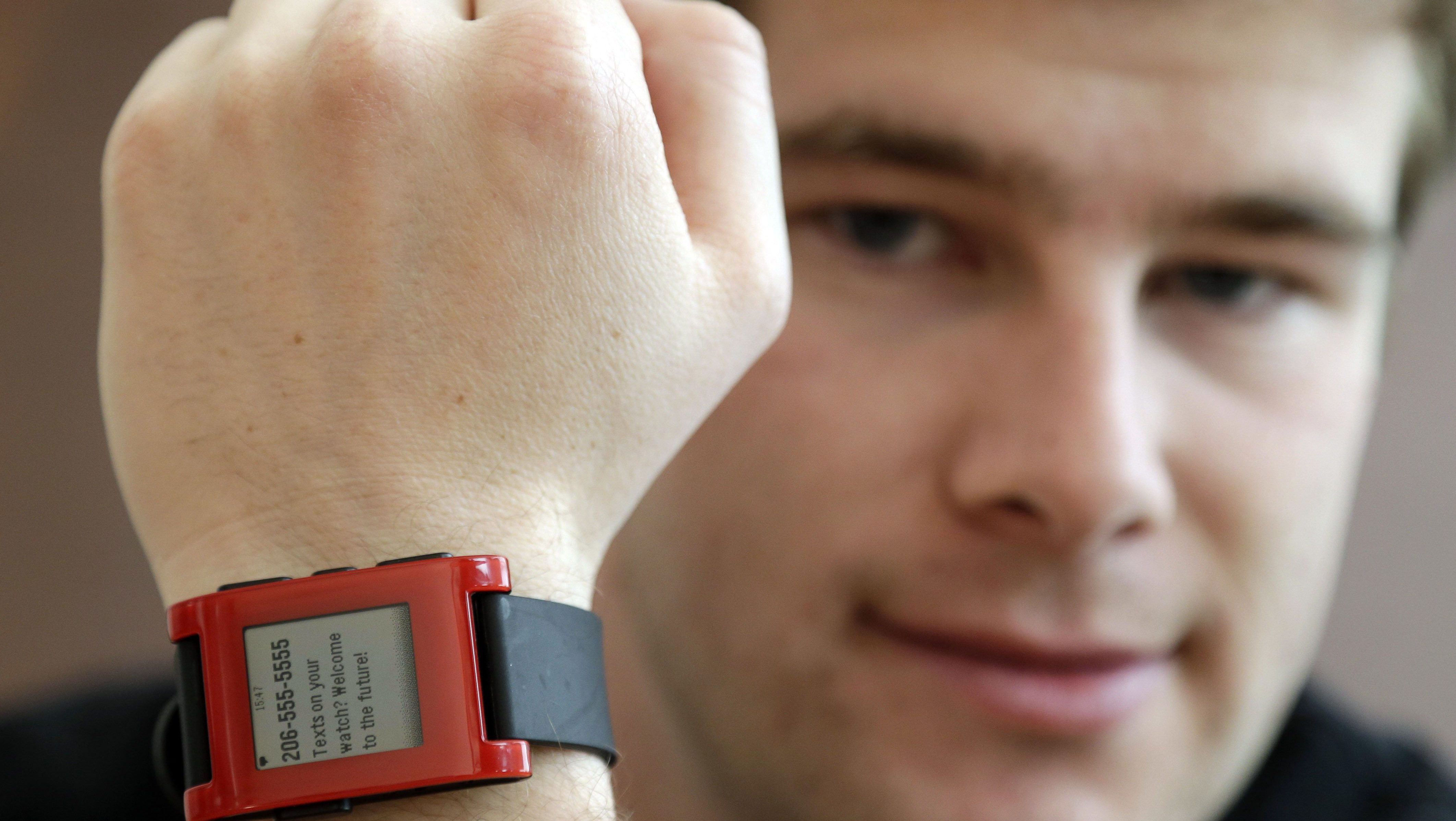 Eric Migicovsky, CEO of Pebble, displays his company's smart watch in Palo Alto, Calif., Tuesday, Feb. 12, 2013.  This new watch not only tells time, but also connects to smart phones within 10 meters.