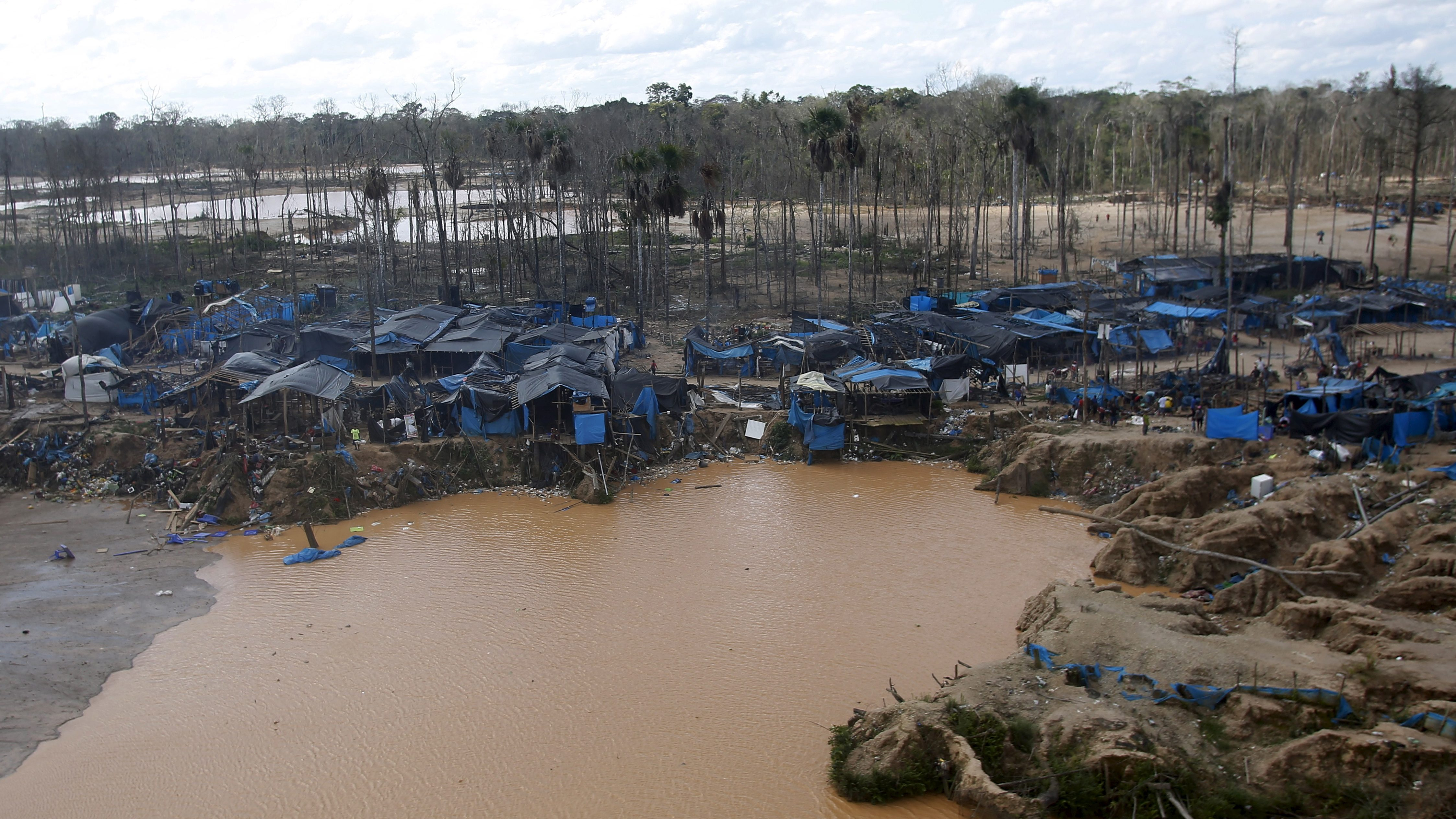 A view of an illegal gold mining camp in a zone known as Mega 14, in the southern Amazon region of Madre de Dios July 14, 2015. Peruvian police razed dozens of illegal gold mining camps at the edge of an Amazonian nature reserve this week, part of a renewed bid to halt the spread of wildcatting in a remote rainforest region. The stings at the edge of the Tambopata National Reserve were the first in the southeastern region of Madre de Dios since a crackdown let up in December. Production from wildcat miners in Madre de Dios, who sell their ore up the supply chain, made up about 10 percent of national production before President Ollanta Humala launched the harshest crackdown yet on illegal gold mining last year.