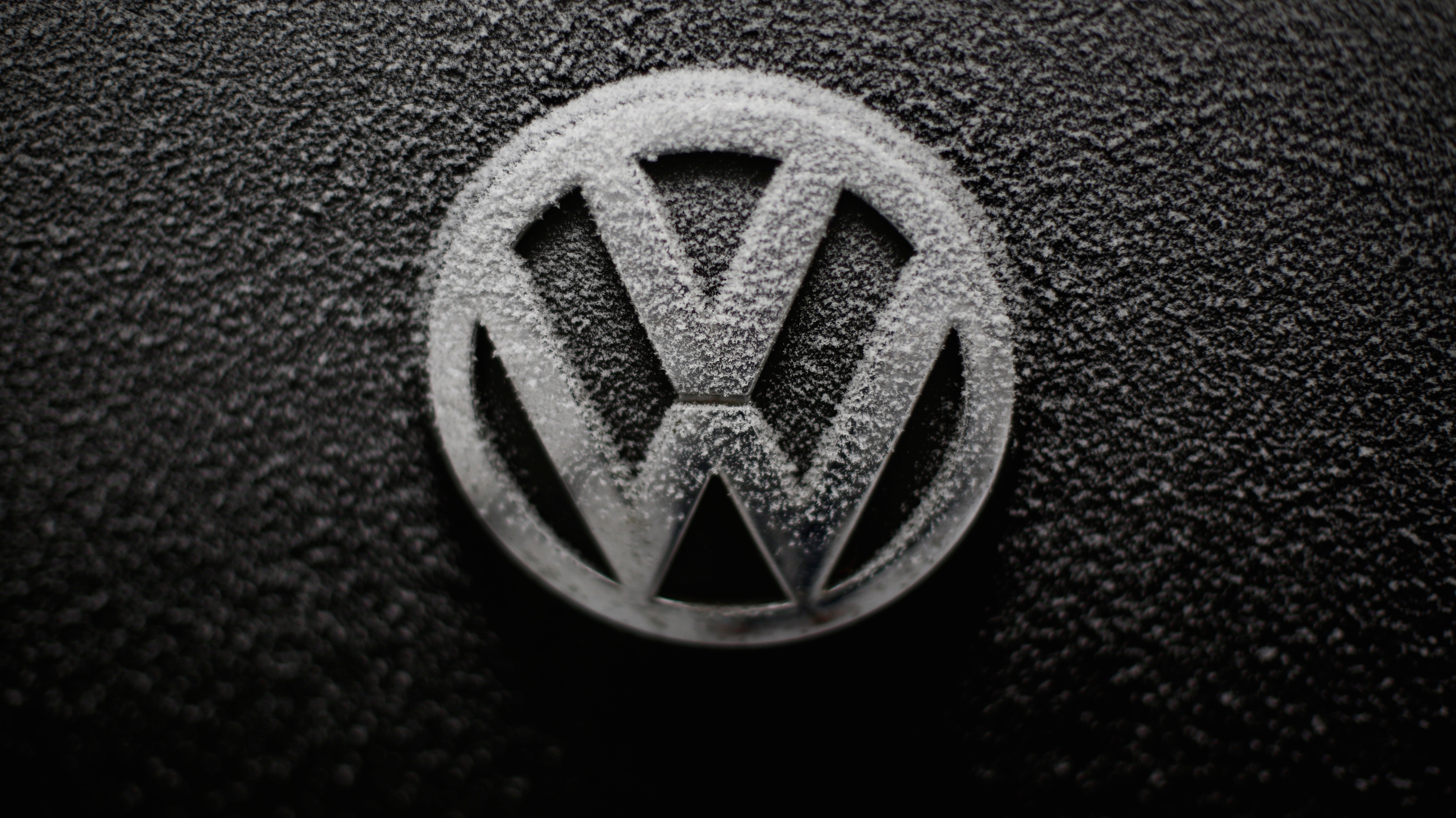 VW logo on car with snowflakes.