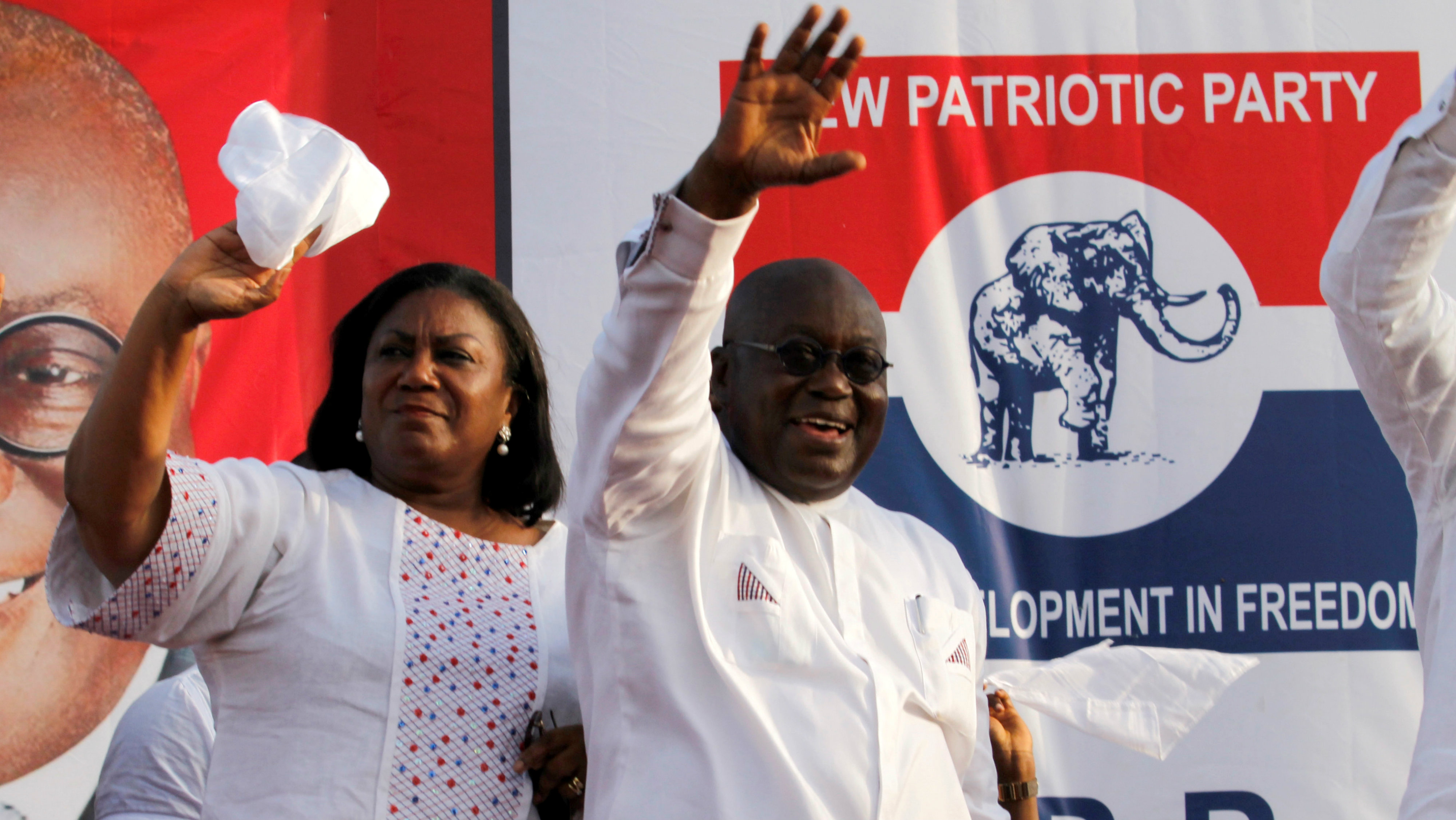 Ghanaian presidential candidate Nana Akufo-Addo of the opposition New Patriotic Party (NPP) waves with his wife Rebecca during his last rally at a trade fair in Accra December 4, 2016.