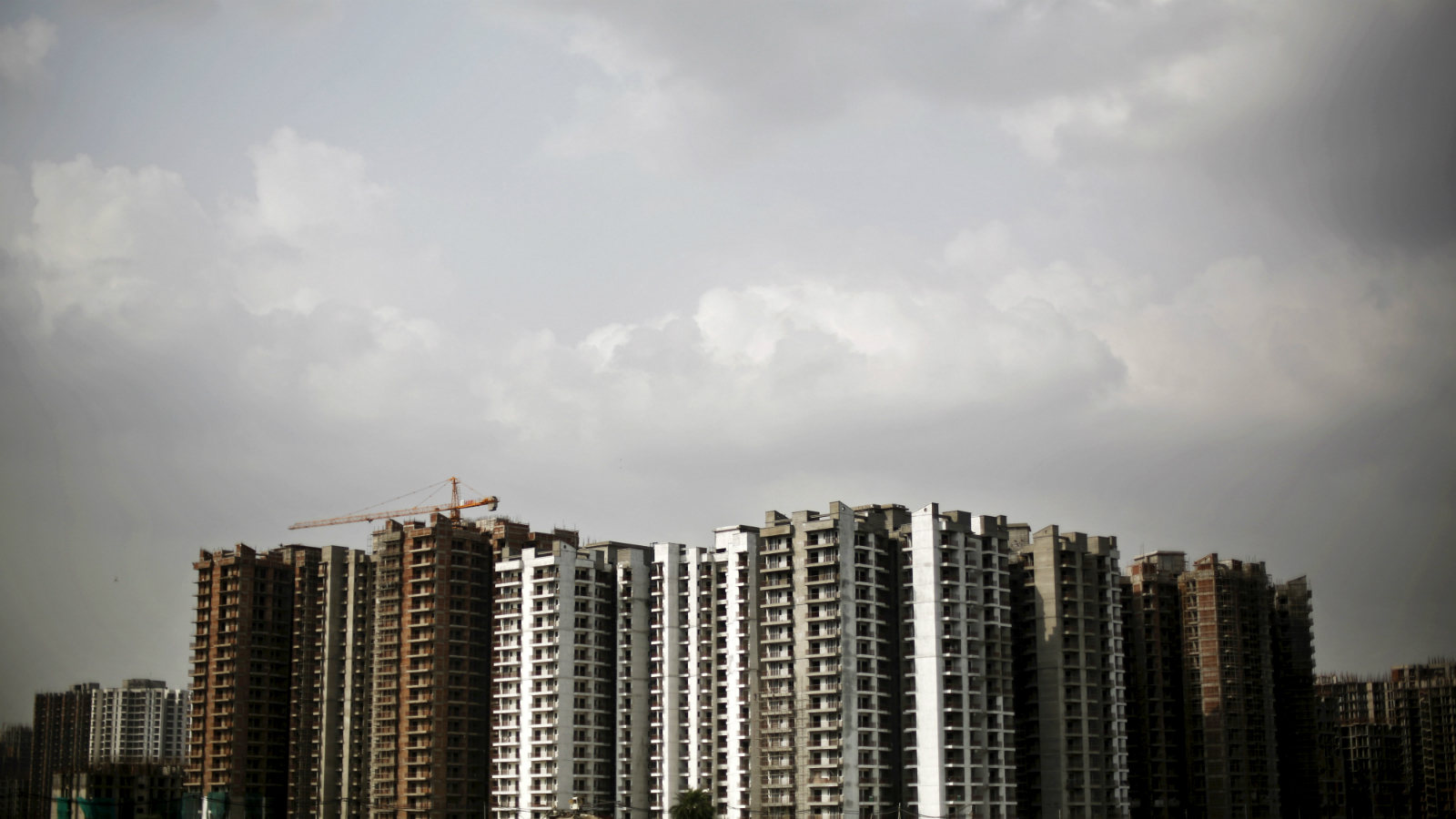 A view shows a residential complex that is under construction in Noida on the outskirts of New Delhi, India, August 20, 2015.