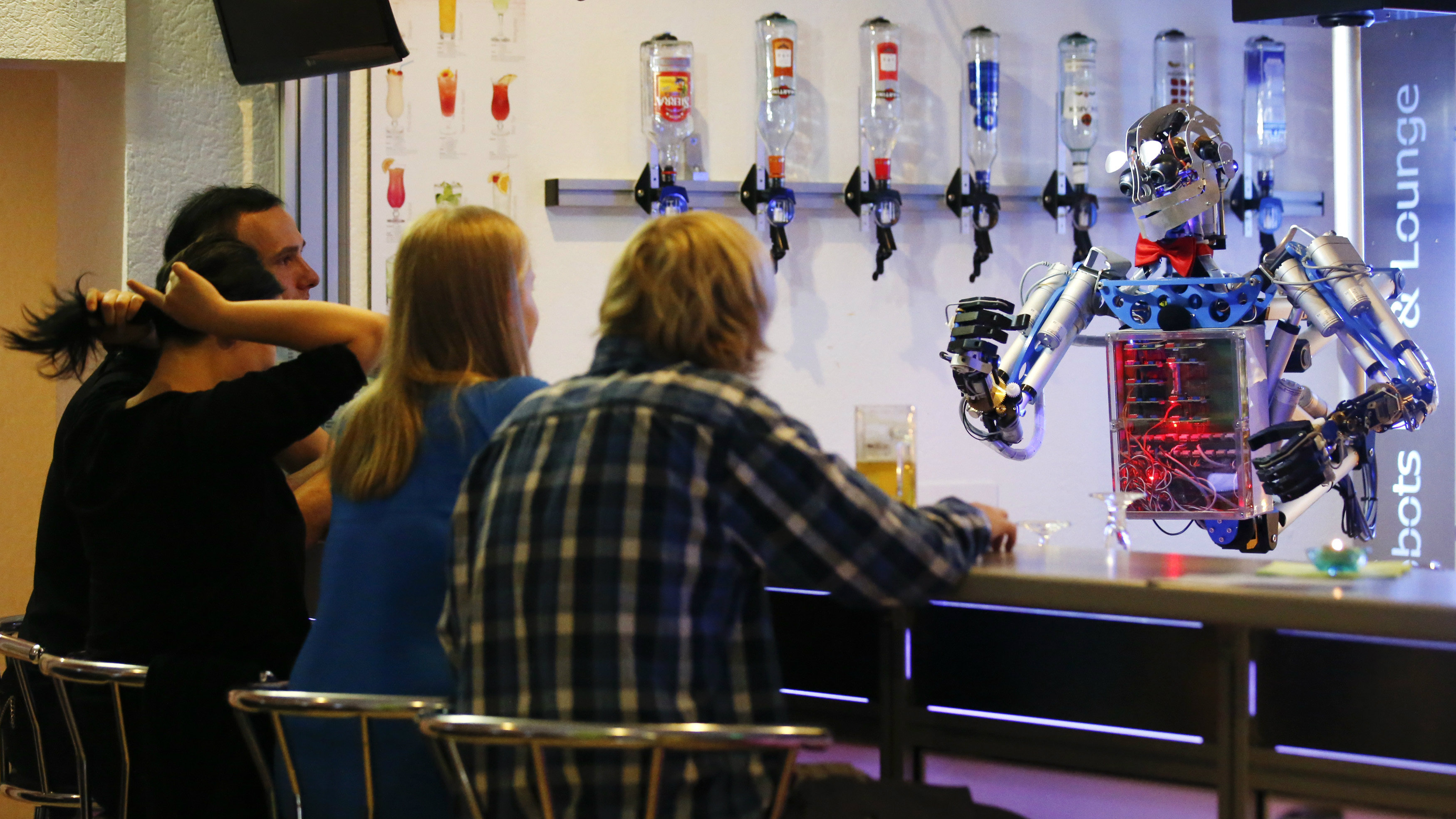 Robot bartender serves customers in Germany