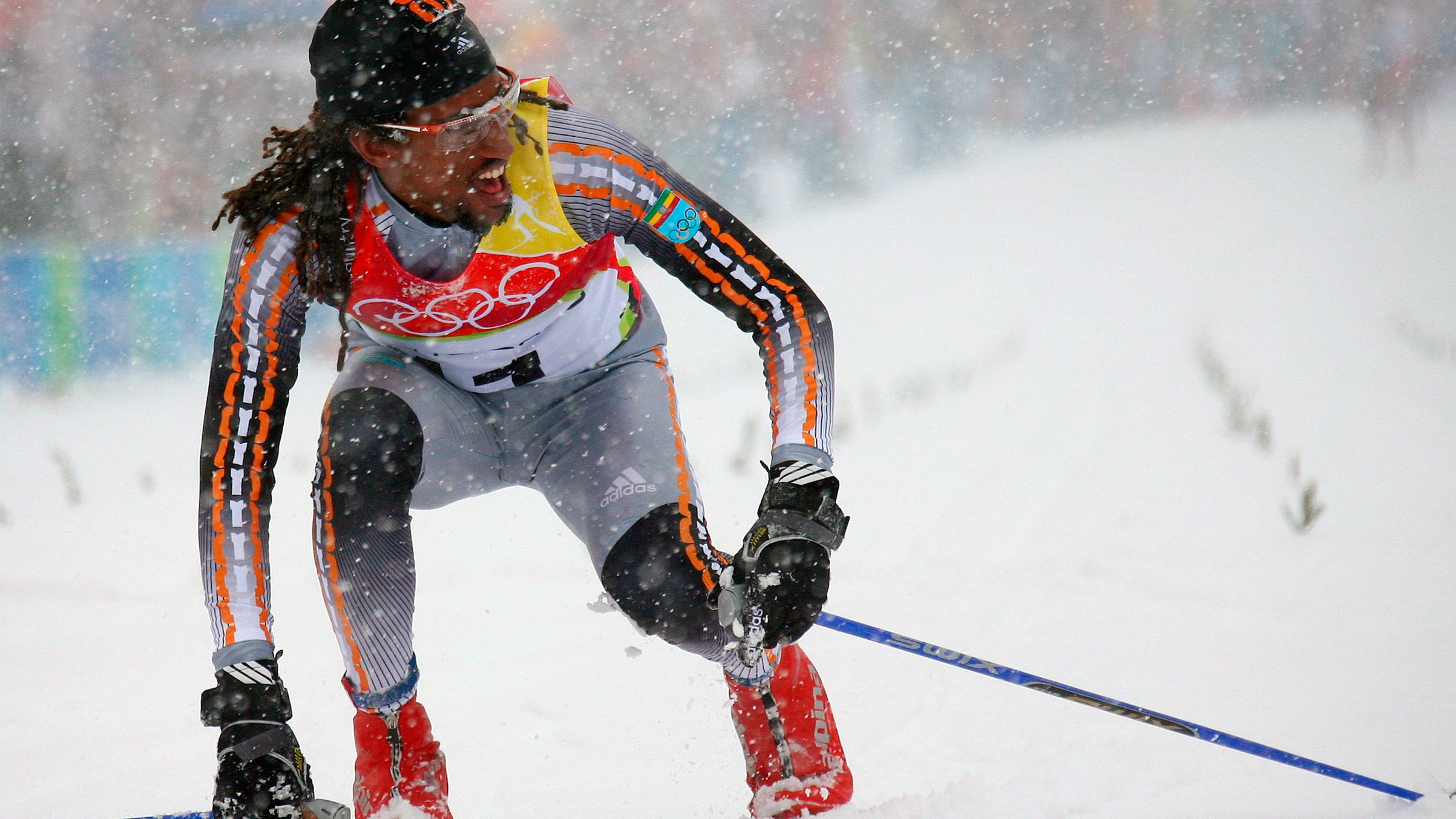 Ethiopia's Teklemariam finishes the men's 15km classical cross country race at the Winter Olympic Games