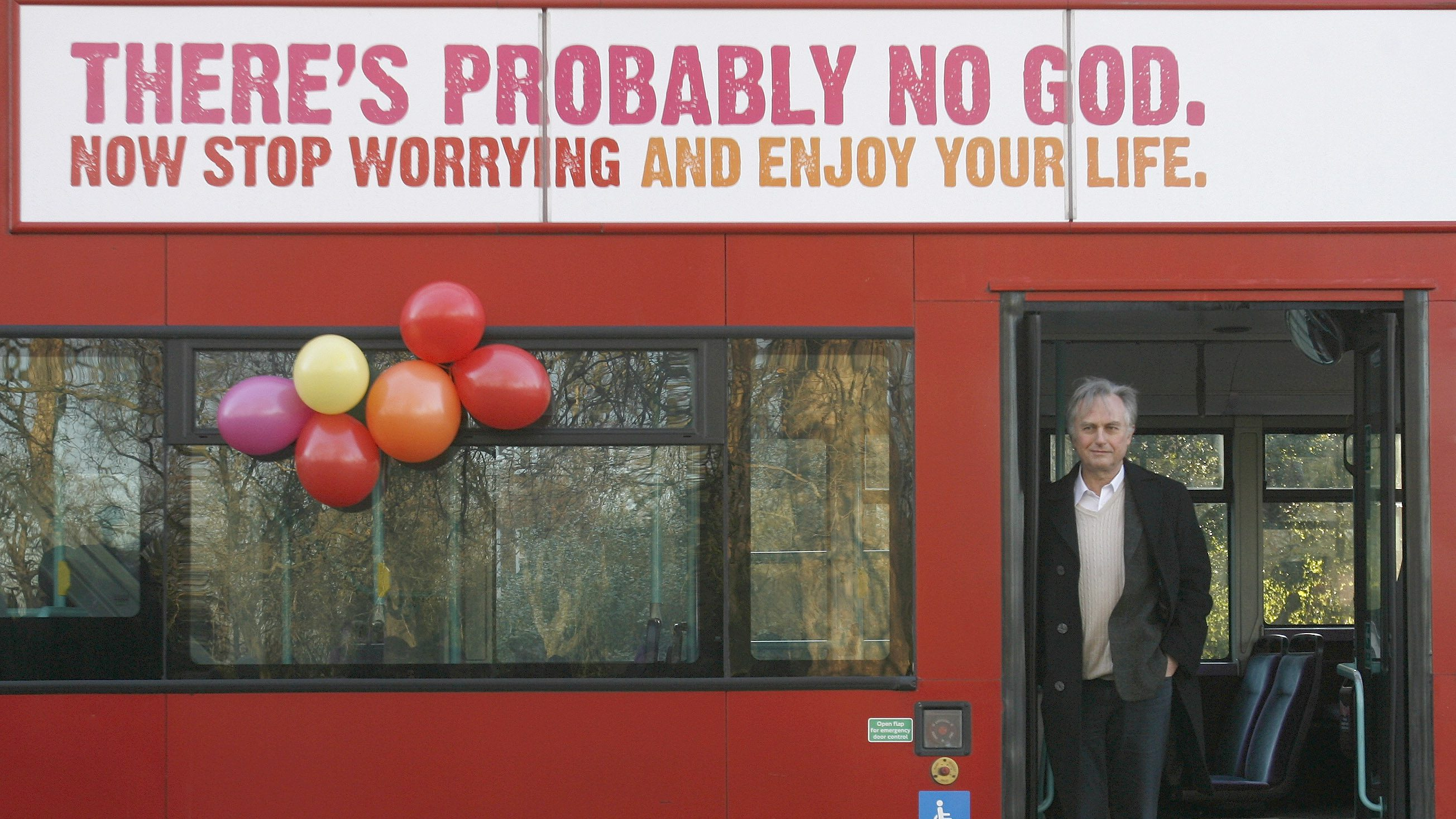 British author Richard Dawkins, who wrote The God Delusion,  stands on a bus at the launch of an atheist advertising campaign, in London January 6, 2009. The UK's first atheist advertising campaign, the Atheist Bus Campaign, launched on Tuesday.     REUTERS/Andrew Winning (BRITAIN) - RTR233N0