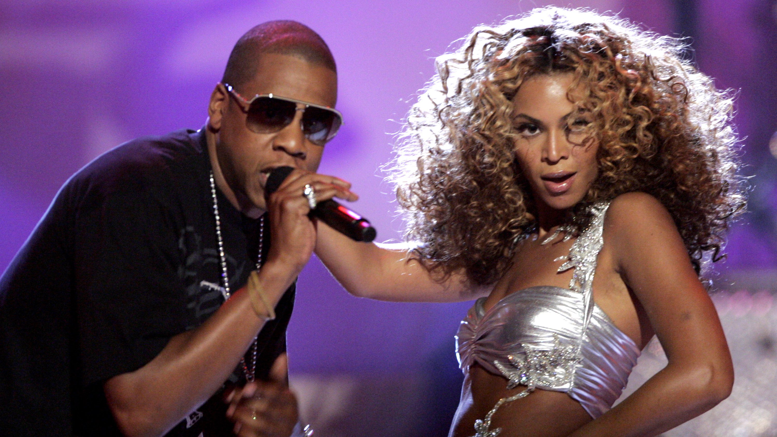 """R&B artist Beyonce (R) performs """"Deja vu"""" with rap artist Jay-Z at the 2006 BET Awards at the Shrine Auditorium in Los Angeles in June 27, 2006 file photo. A new crop of rappers want to emulate the success of rappers-turned-moguls like former New York drug dealers Jay-Z and 50 Cent, who both sold albums based on their transformations from street hustling to popping champagne."""