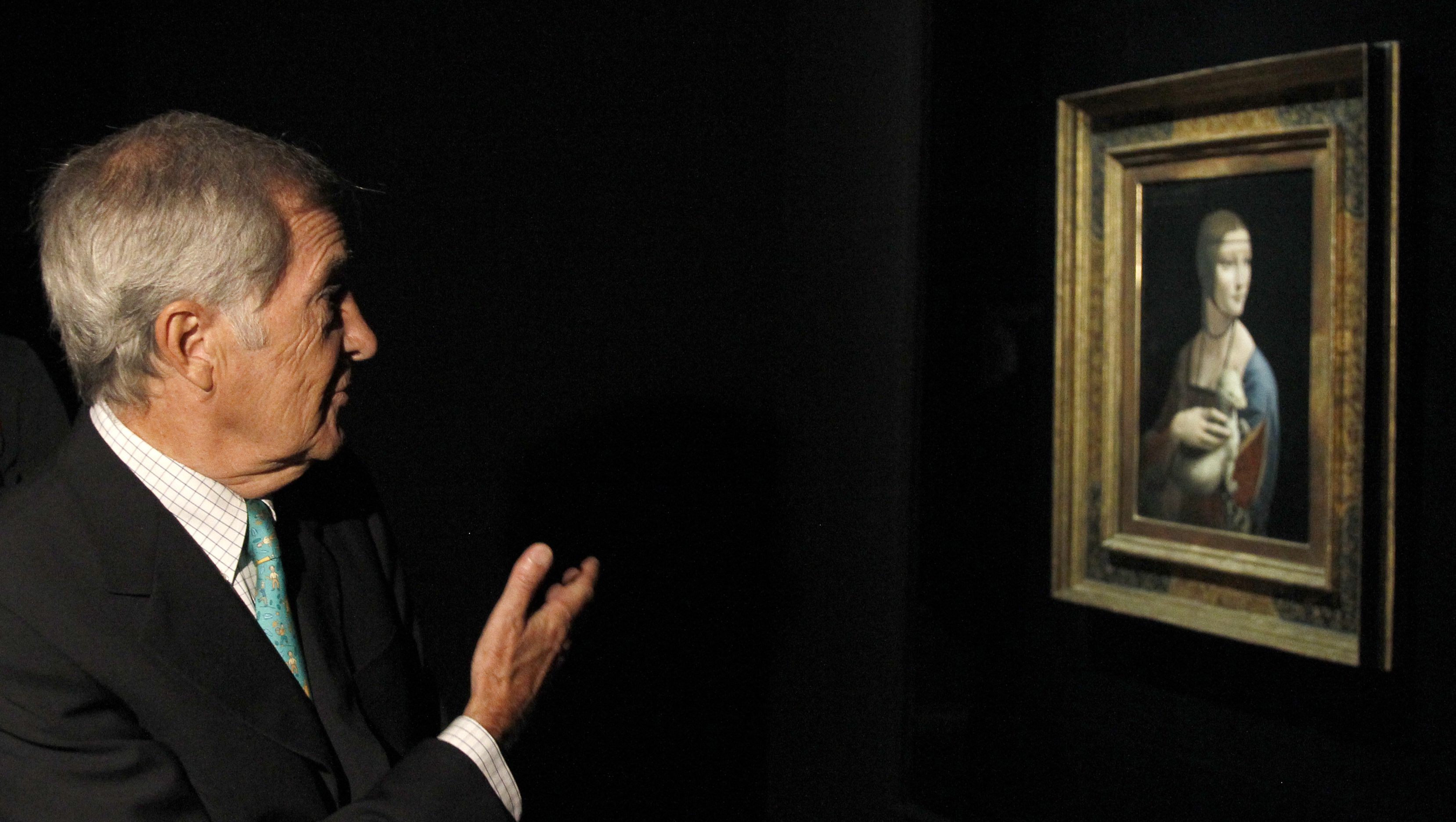 """Prince Adam Czartoryski of Poland owner of the portrait """"Dame mit dem Hermelin"""" (""""The Lady with Ermine"""") by Leonardo da Vinci, gives a TV interview beside the painting before the opening of the exhibition """"Gesichter der Renaissance"""" (Renaissance Faces) at the Bode museum in Berlin August 24, 2011. The exhibition of some 170 masterpieces of Italian portraiture runs from August 25 till November 20 in the German capital.  REUTERS/Tobias Schwarz (GERMANY - Tags: ENTERTAINMENT ROYALS) - RTR2Q9GP"""