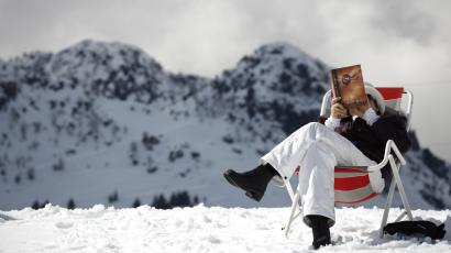 A woman reads a copy of the The Secret at the Laqlouq ski resort about an hour from Beirut