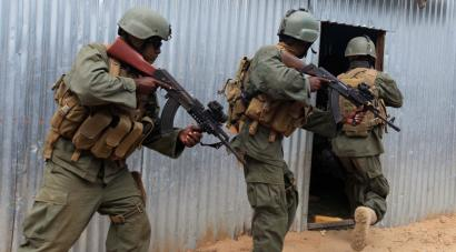 Somali government security forces patrol the streets of Elasha