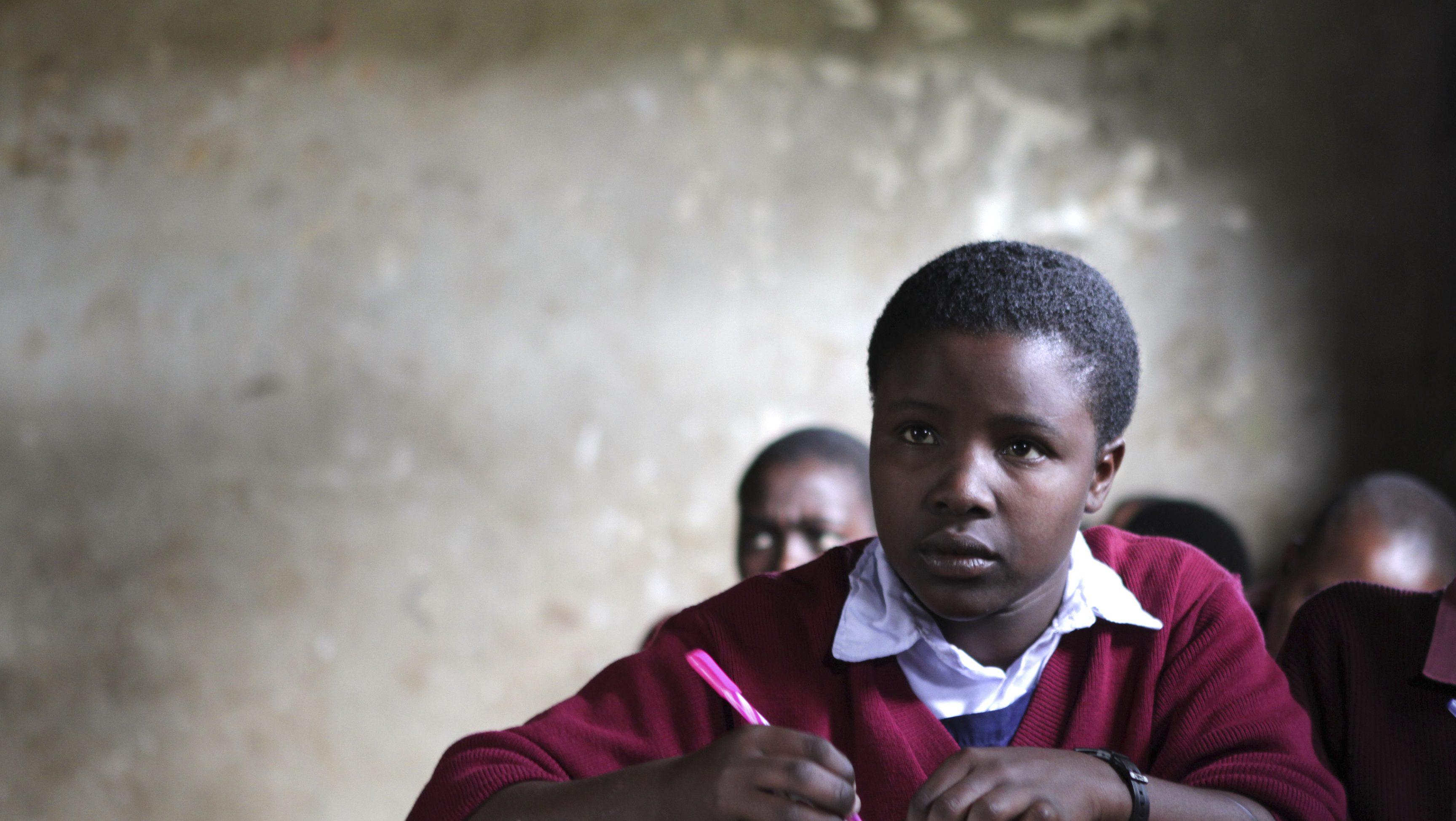 Metian sits in her classroom in Sajiloni Primary School in the semi-arid Kajiado County