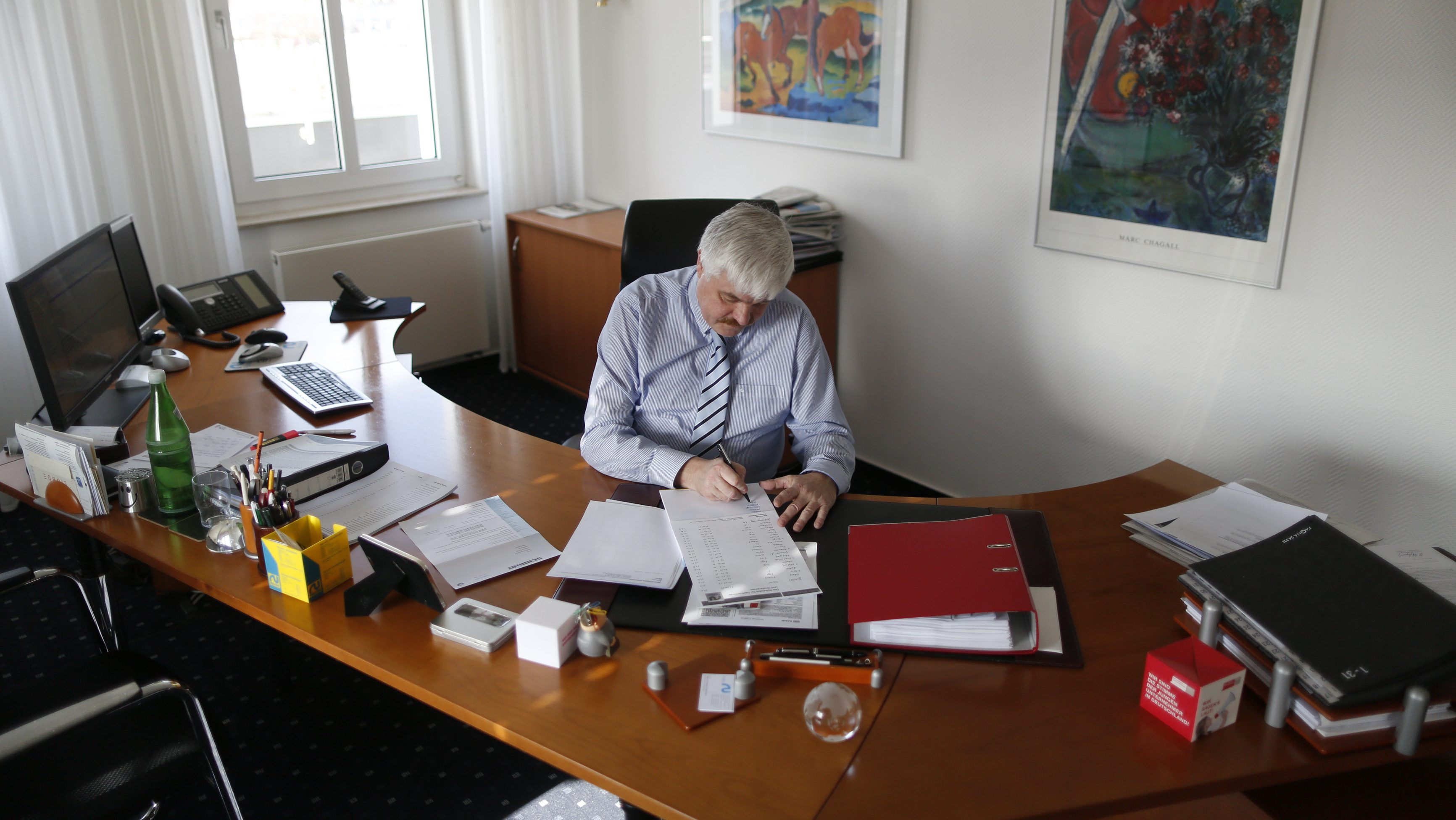Roger Schnecke, a 56-year old sales representative is pictured at his office at the headquarters of Rullko wholesale in Hamm March 4, 2014.