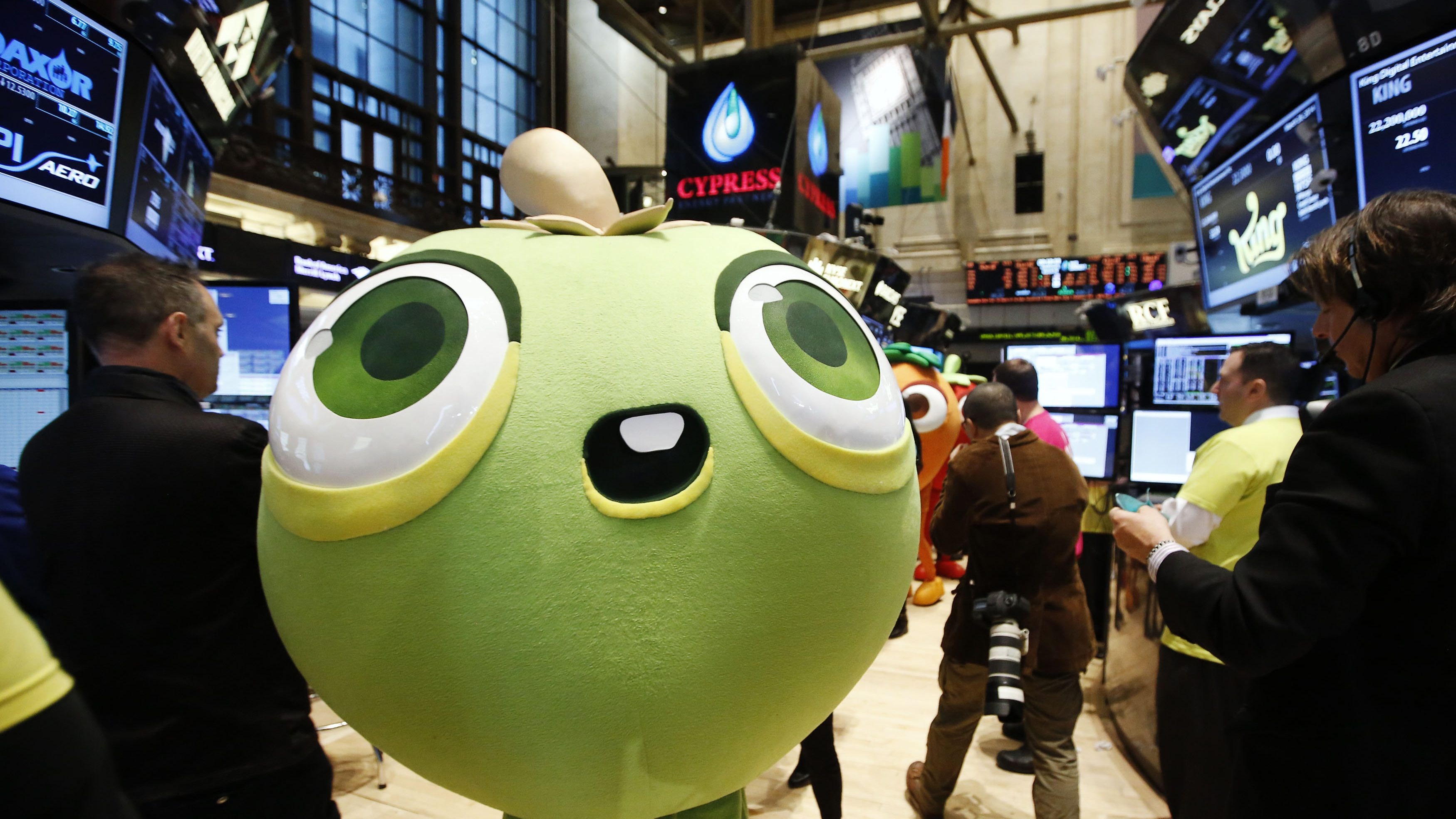 """A mascot dressed as a character from the mobile game """"Candy Crush Saga"""" walks the floor of the New York Stock Exchange during the IPO of Mobile game maker King Digital Entertainment Plc"""