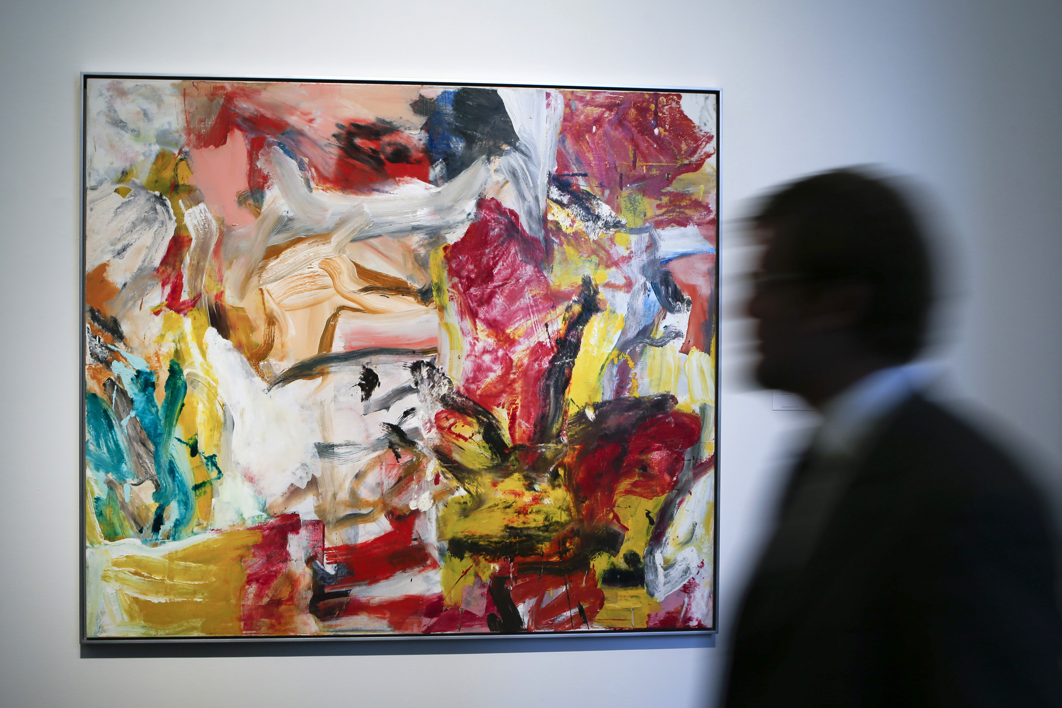 "A man walks past ""Untitled"" by Willem De Kooning during a preview of Sotheby's impressionist and modern art evening sale in New York, May 2, 2014. REUTERS/Eduardo Munoz (UNITED STATES - Tags: SOCIETY ENTERTAINMENT) - RTR3NLE1"
