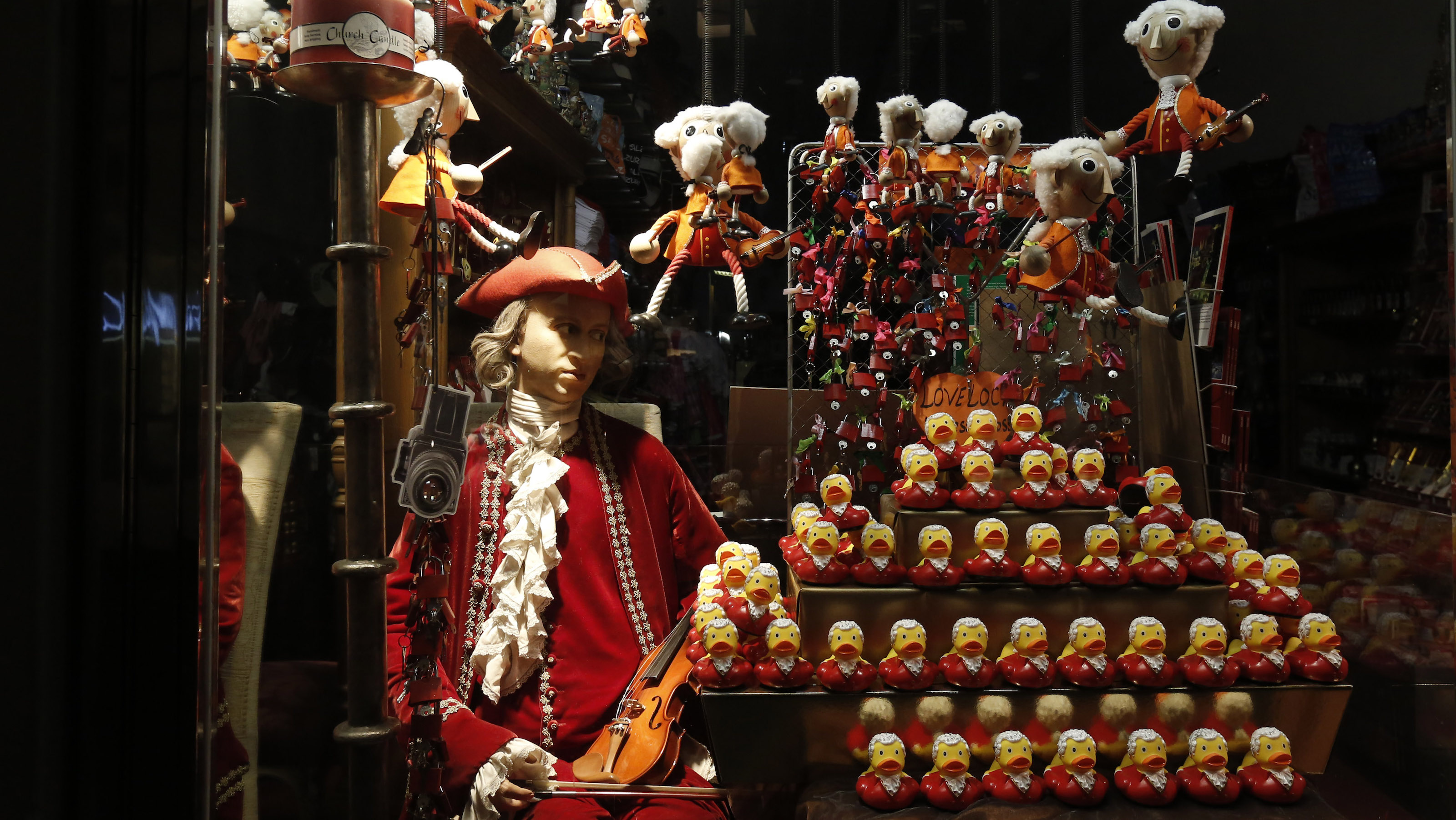 Mozart puppets and Mozart ducks are pictured in a shop in the city of Salzburg July 23, 2014. The Salzburg Festival, one of the biggest cultural festivals worldwide, will take place from July 27 to August 31, 2014. More than 270 performances in the genres of opera, drama and concert are scheduled at 16 performance venues in Salzburg during the festival. Picture taken July 23, 2014. REUTERSLeonhard Foeger (AUSTRIA - Tags: ENTERTAINMENT TPX IMAGES OF THE DAY) - RTR403DG