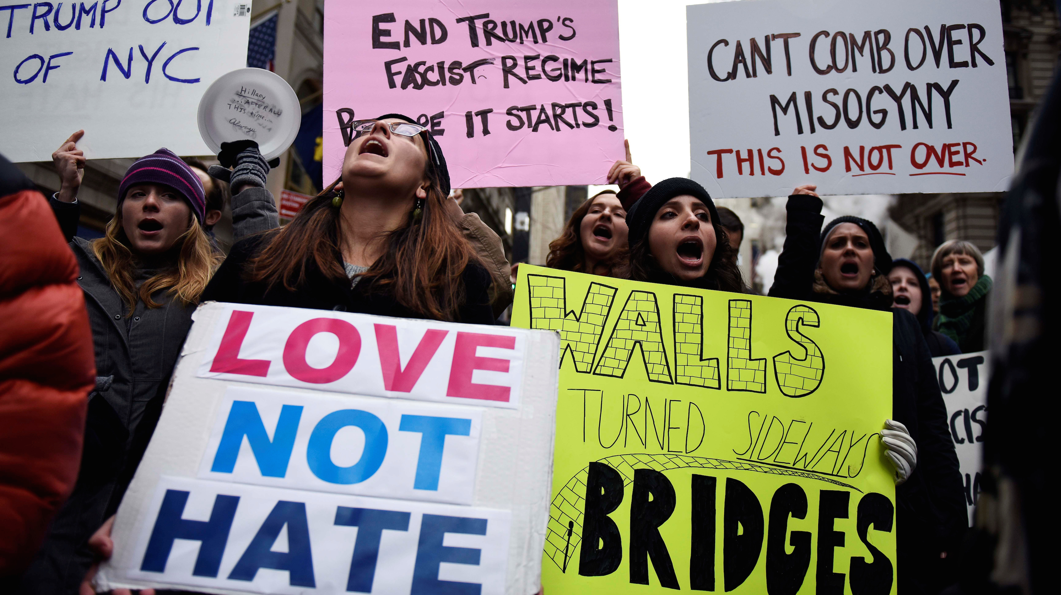 Protesters against U.S. President-elect Donald Trump shout slogans while demonstrating near Trump Tower in the Manhattan borough of New York, U.S. November 20, 2016.
