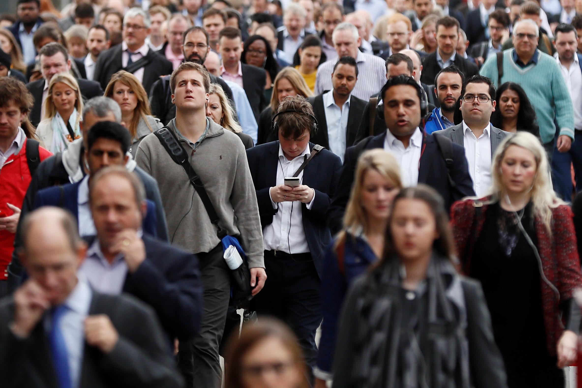 Commuters cross the London Bridge