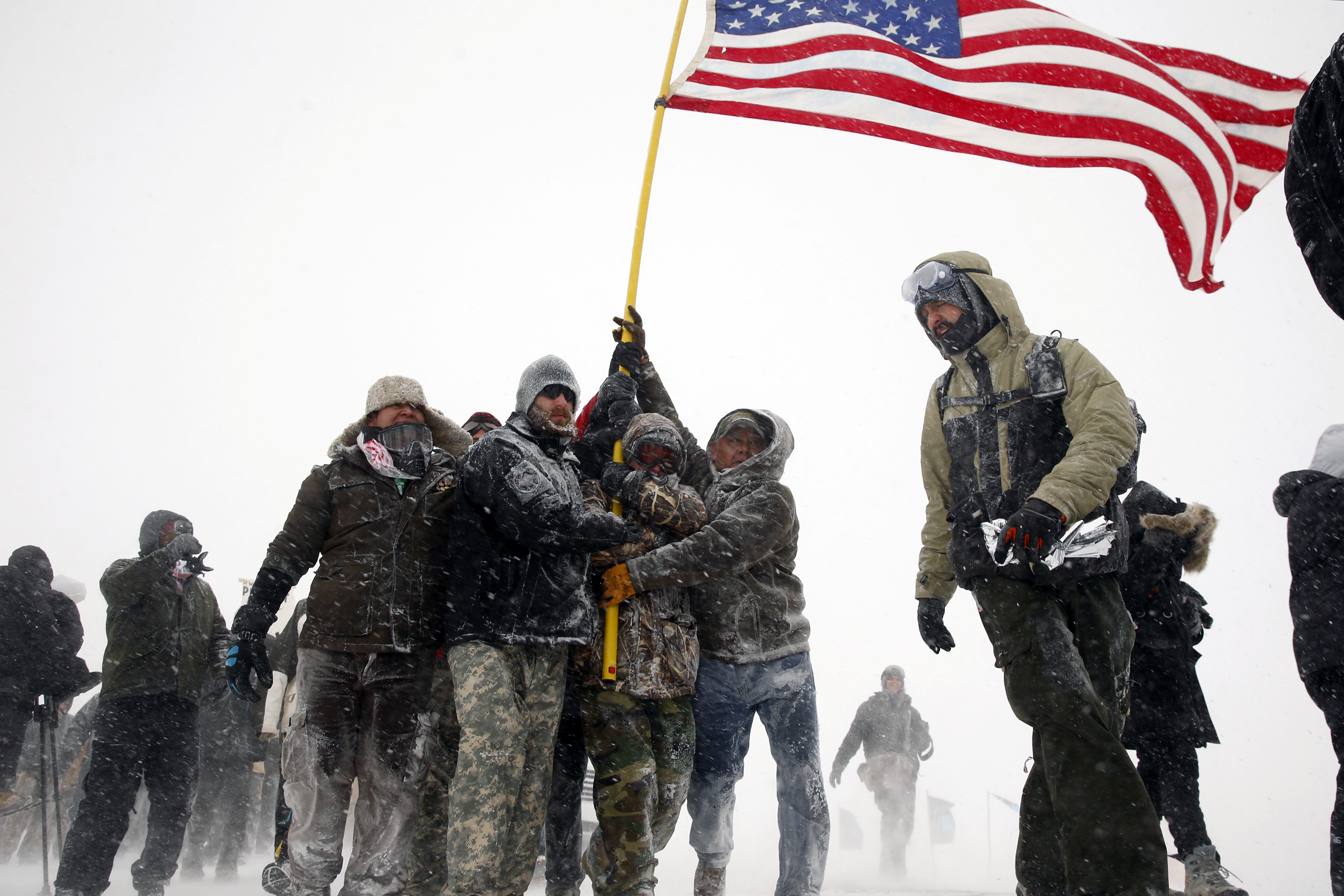 Veterans join activists in a march to Backwater Bridge just outside of the Oceti Sakowin camp in North Dakota