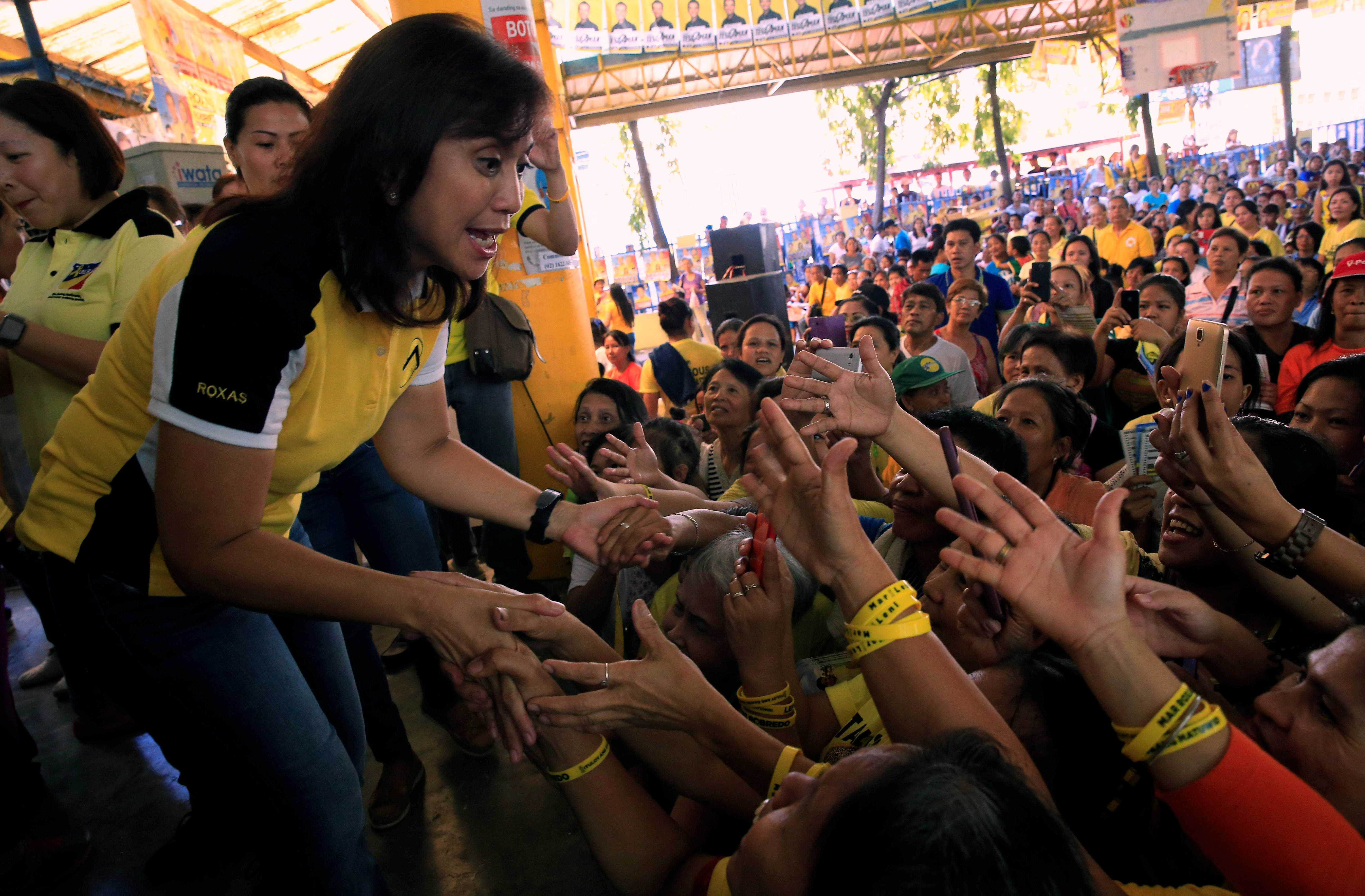 Philippine Vice-presidential candidate and congresswoman Leni Robredo is greeted by supporters during her campaign rally in Quezon City, Metro Manila, Phillipines May 4, 2016.