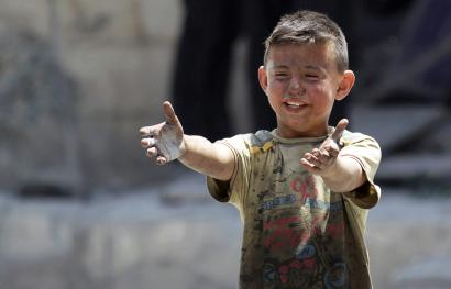 A boy, whose brother was killed, reacts at a site hit by airstrikes in the rebel-controlled area of Maaret al-Numan town in Idlib province, Syria June 2, 2016.