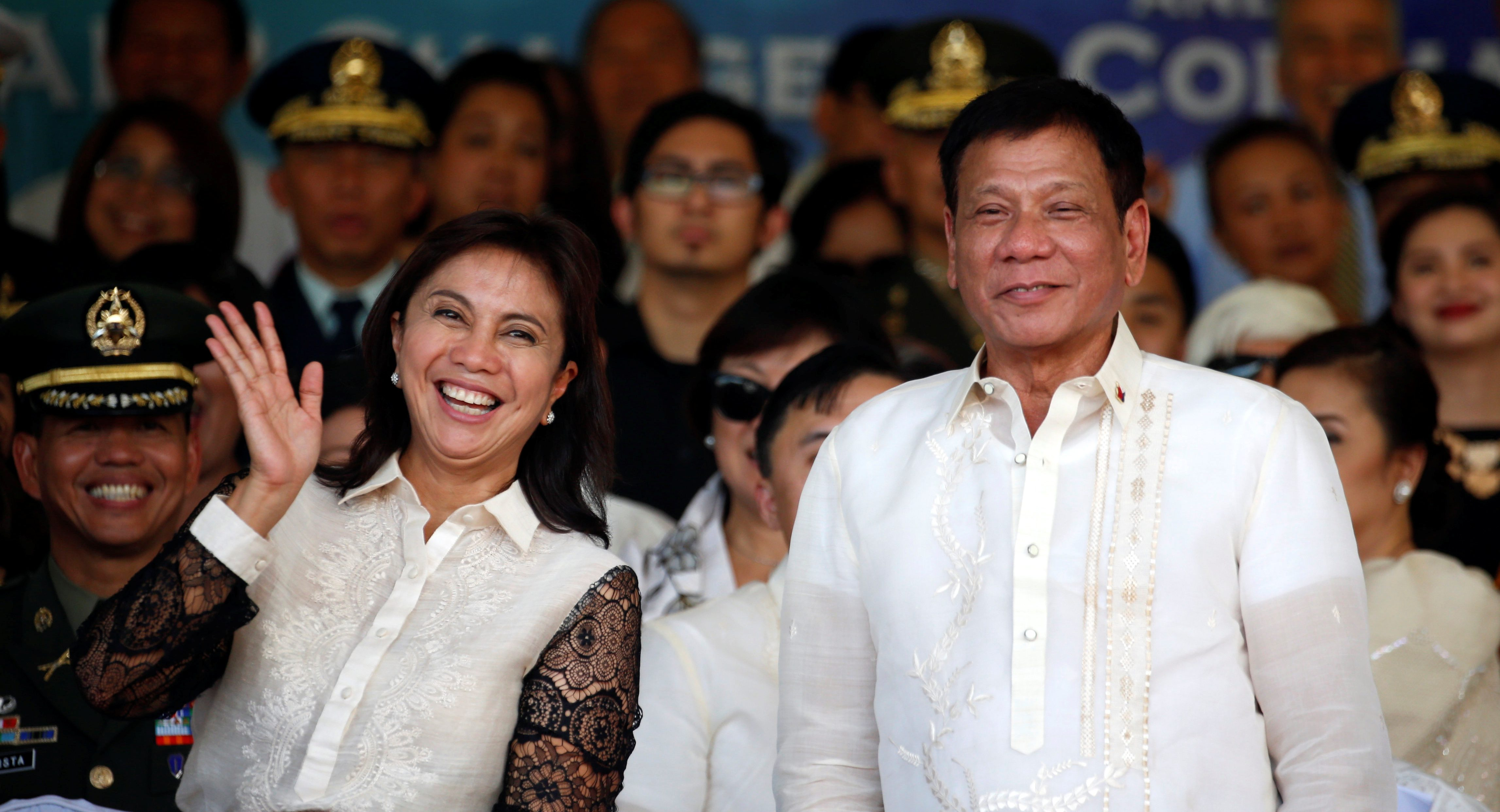Philippines President Rodrigo Duterte and Vice President Leni Robredo pose after a military parade at main military Camp Aguinaldo in Quezon city Metro  Manila, Philippines July 1, 2016.  REUTERS/Erik De Castro     TPX IMAGES OF THE DAY      - RTX2J6JT
