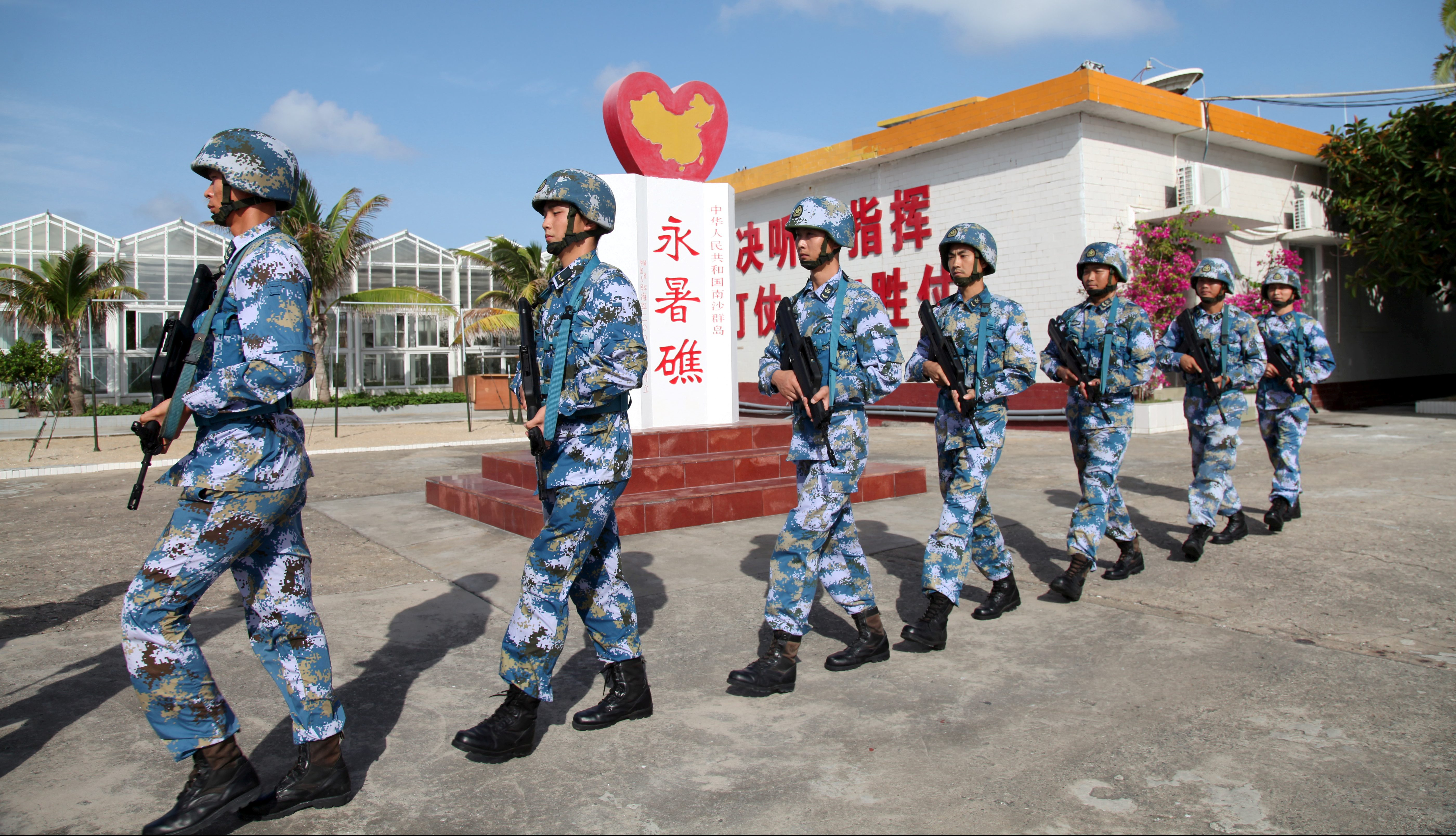 Soldiers of China's People's Liberation Army (PLA) Navy patrol at Fiery Cross Reef, in the Spratly Islands, known in China as the Nansha Islands, February 9, 2016.