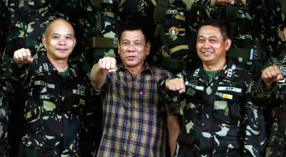 "Philippine President Rodrigo Duterte makes a ""fist bump"""