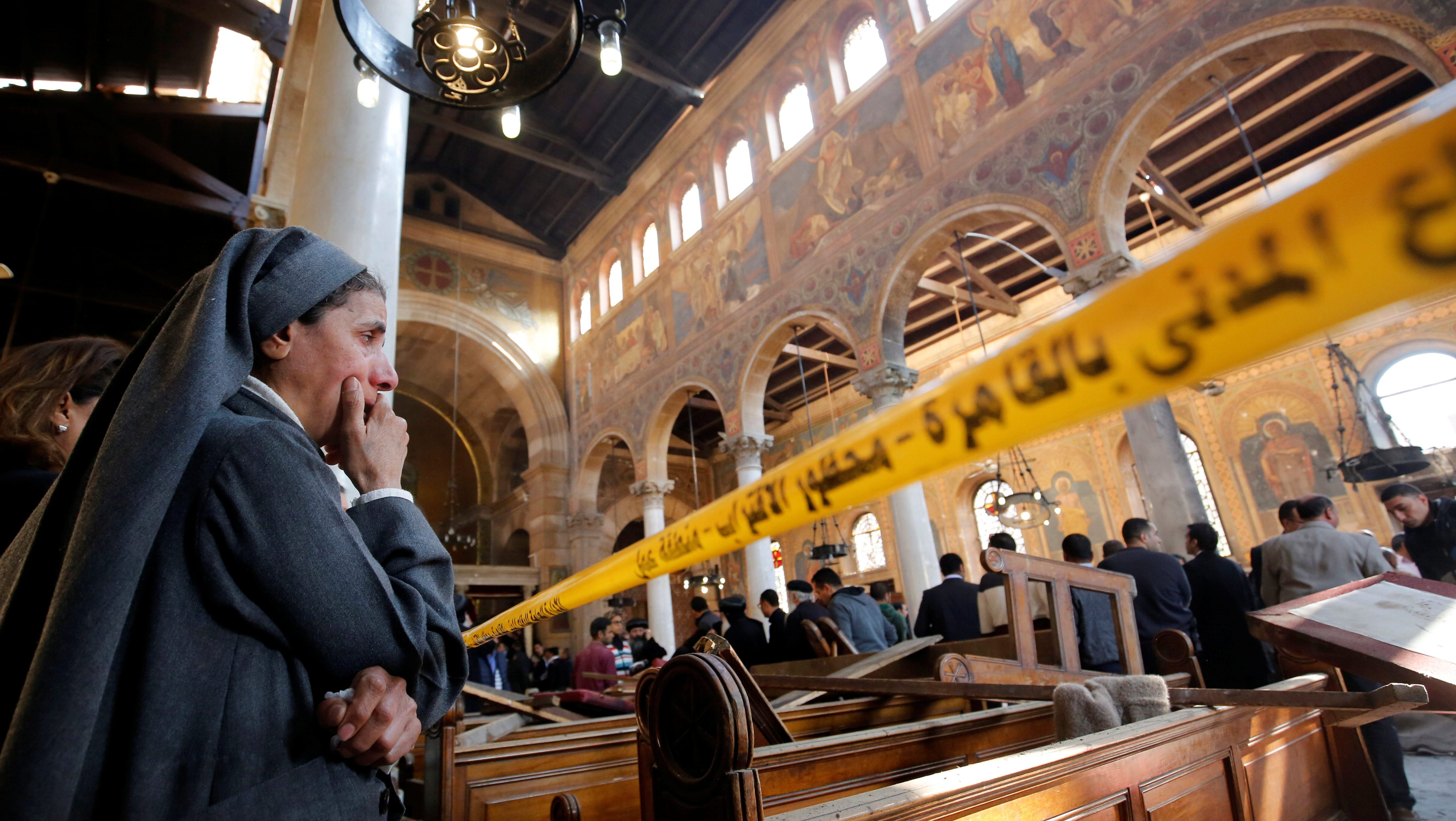 A nun cries as she stands at the scene inside Cairo's Coptic cathedral, following a bombing, in Egypt