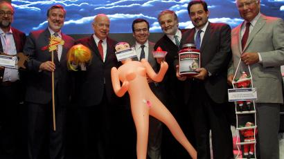 Chile's economy minister Luis Cespedes holds up an inflatable doll during an event of the exporters' association Asexma in Santiago