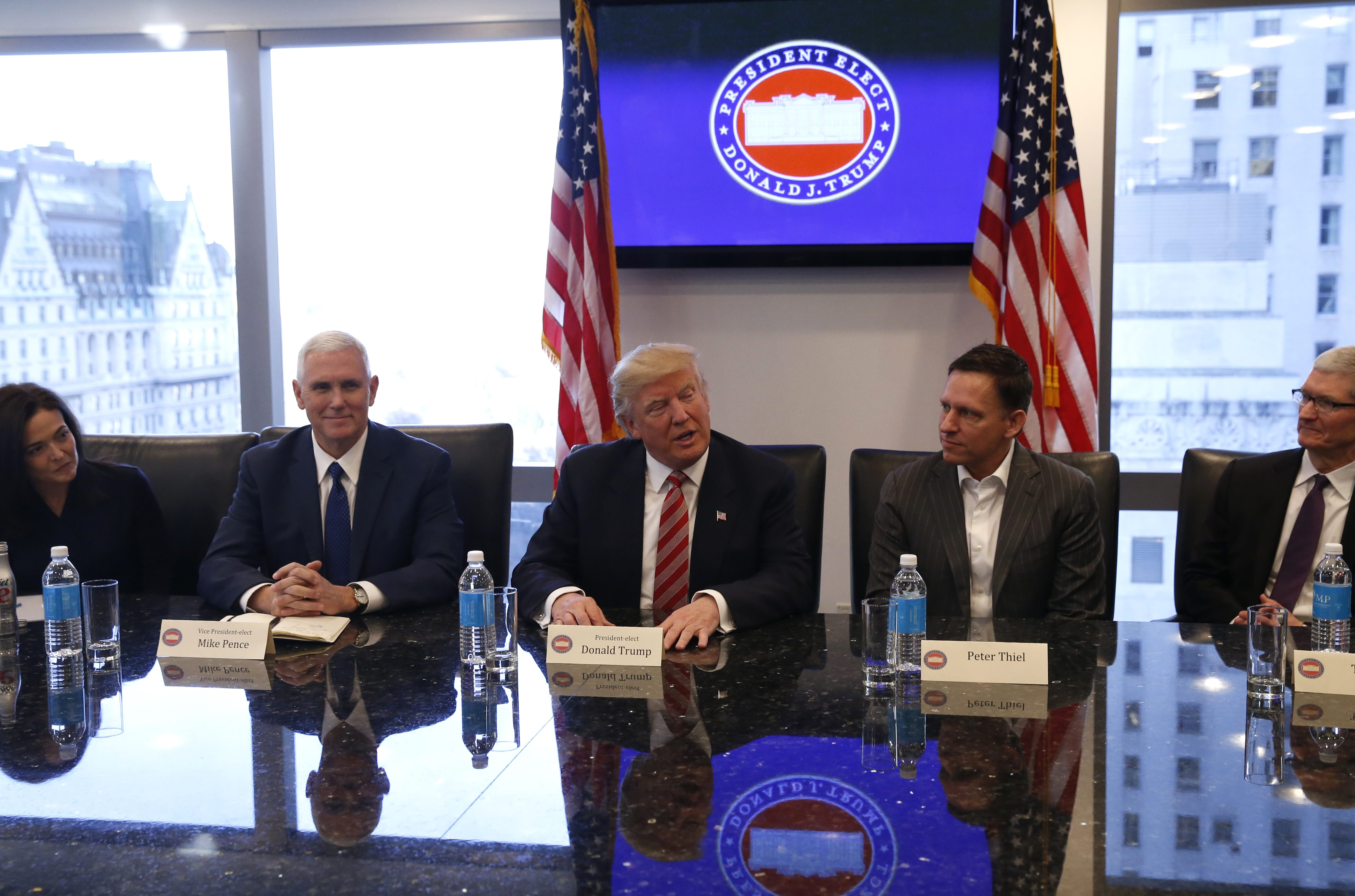 U.S. President-elect Donald Trump (C) sits with Vice President-elect Mike Pence (2ndL) PayPal co-founder and Facebook board member Peter Thiel (2ndR), Apple Inc CEO Tim Cook (R) and Facebook COO Sheryl Sandberg during a meeting with technology leaders at Trump Tower in New York, U.S., December 14, 2016. REUTERS/Shannon Stapleton - RTX2V2W7