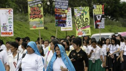 Catholic nuns and students take part in an anti-child pornography rally in Manila November 19, 2008. The group was asking the government for legislation to criminalize child pornography.