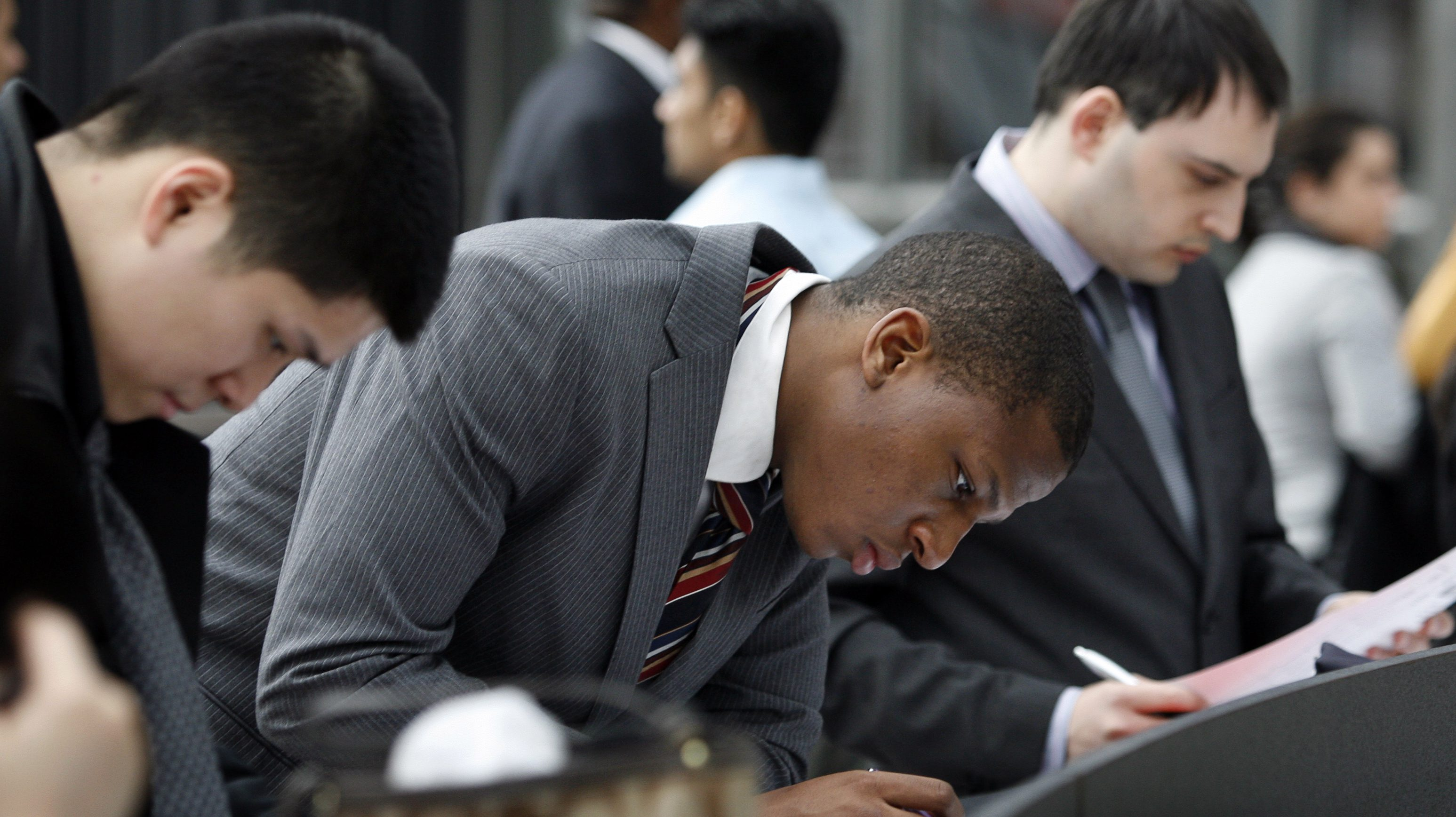 A man looks at a list of employers at the 2009 CUNY Big Apple Job Fair at the Jacob K. Javits Convention Center in New York March 20, 2009.