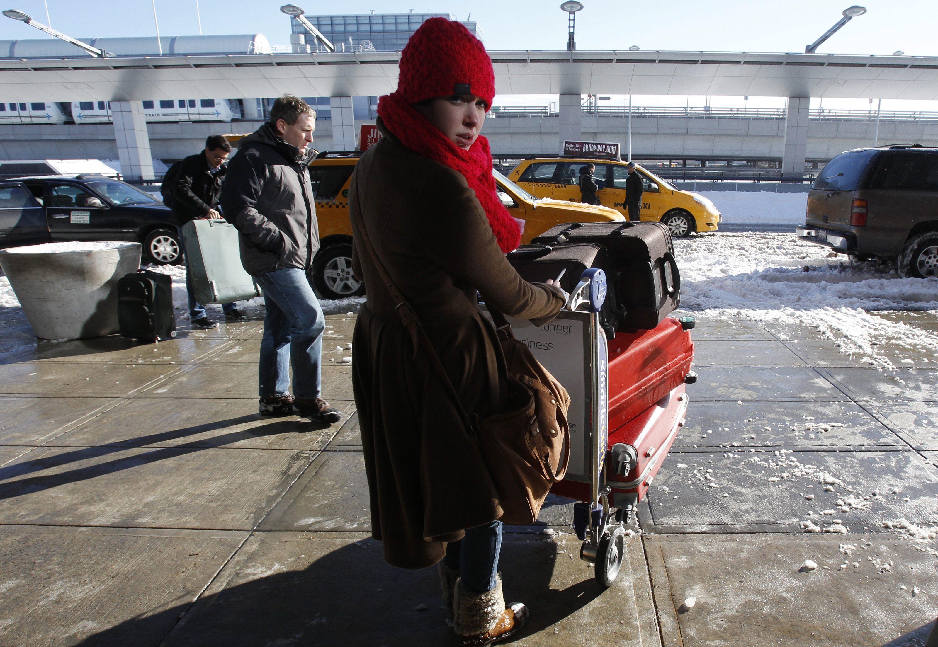 A woman arrives at JFK International Airport