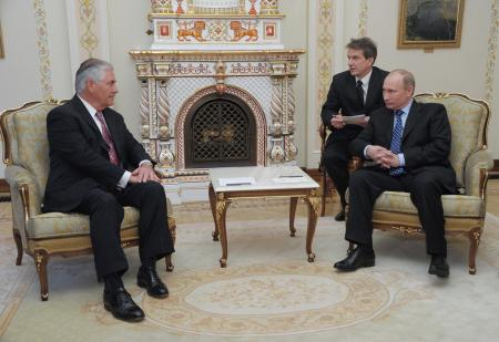 President-Elect and Russian Prime Minister Vladimir Putin (R) talks with Exxon Mobile CEO and Chairman Rex Tillerson (L) during their meeting in Moscow, Russia, 16 April 2012.