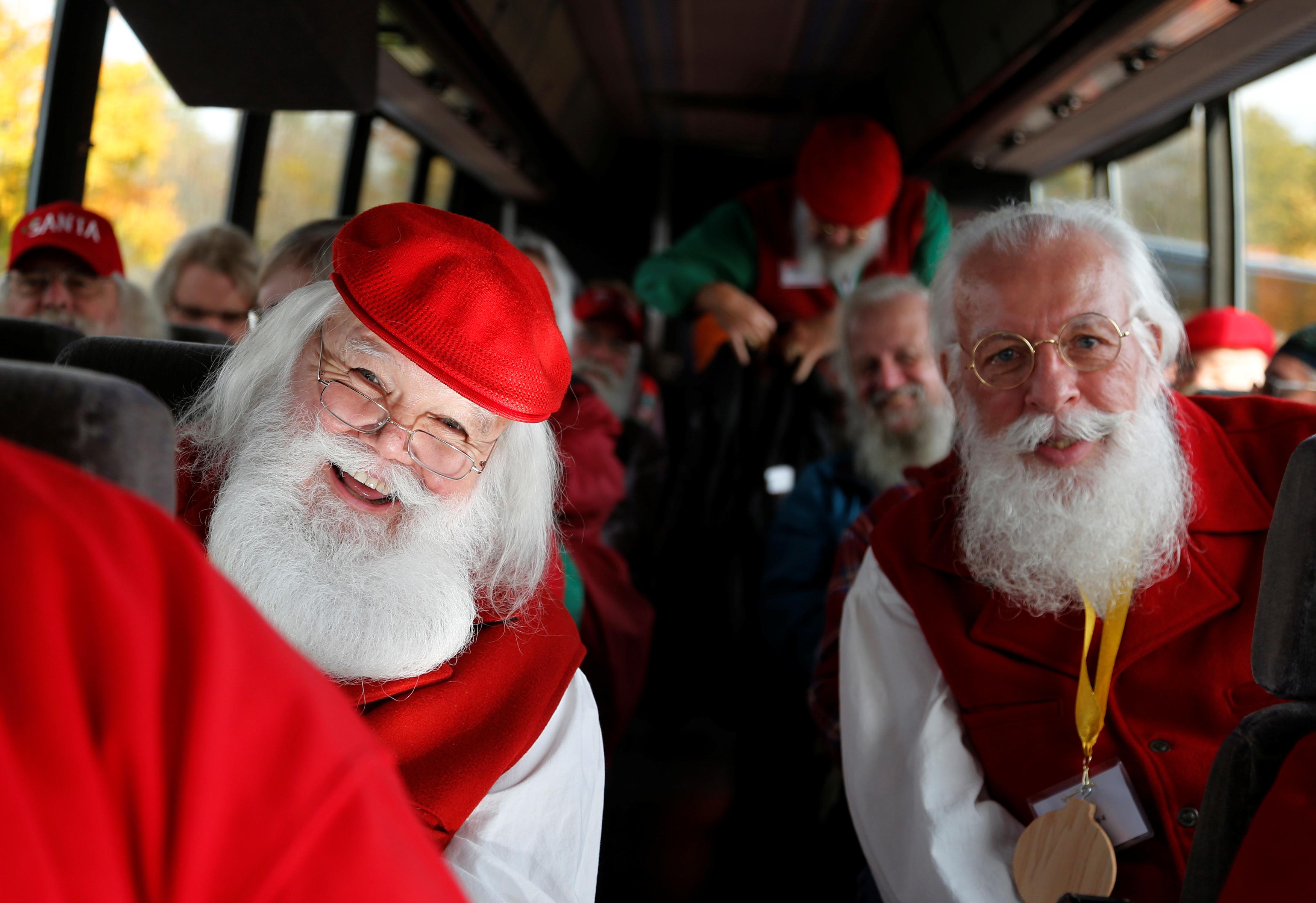 Santas board a bus for a field trip