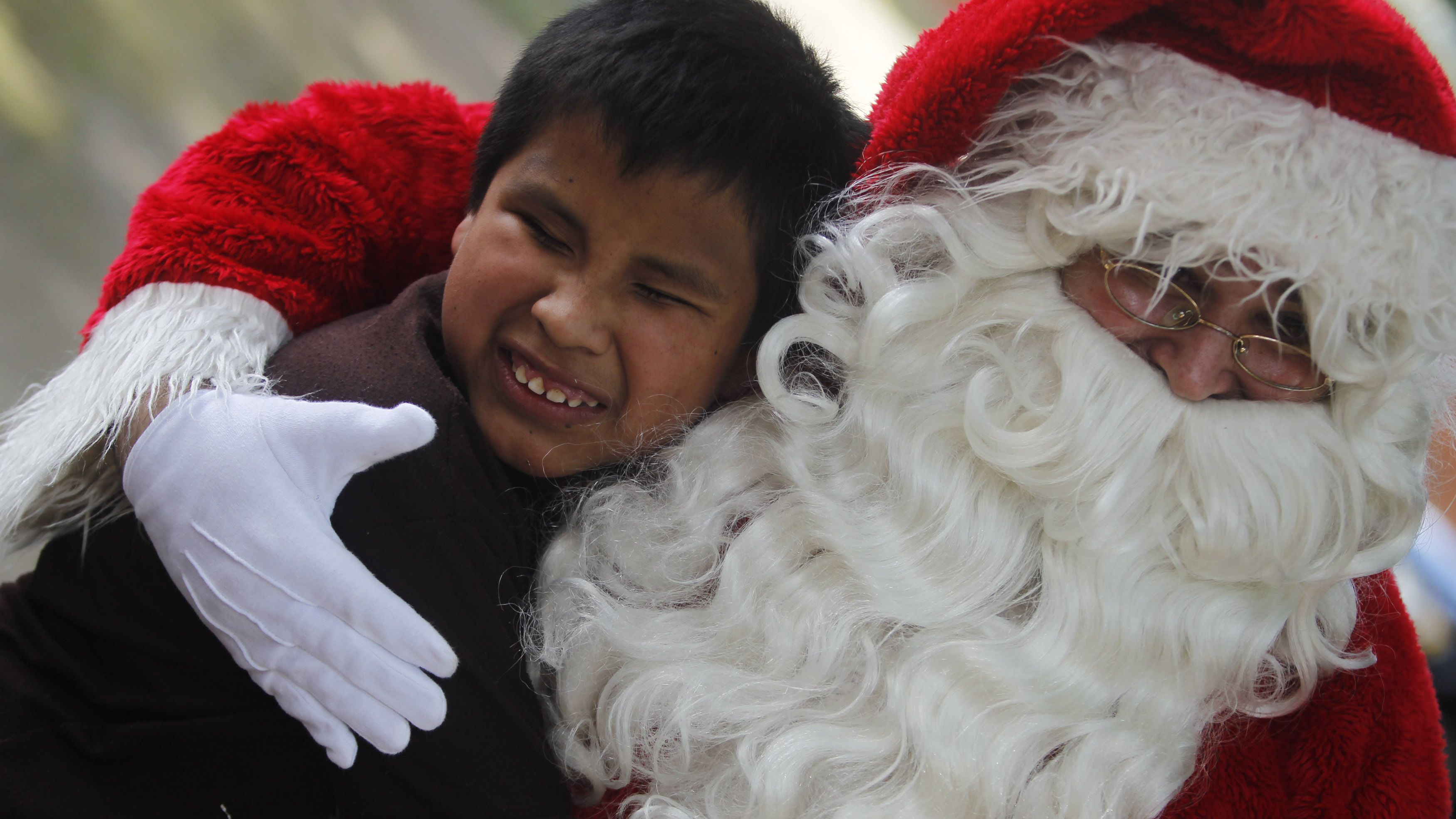 santa claus hugging child - Santa Claus With Kids