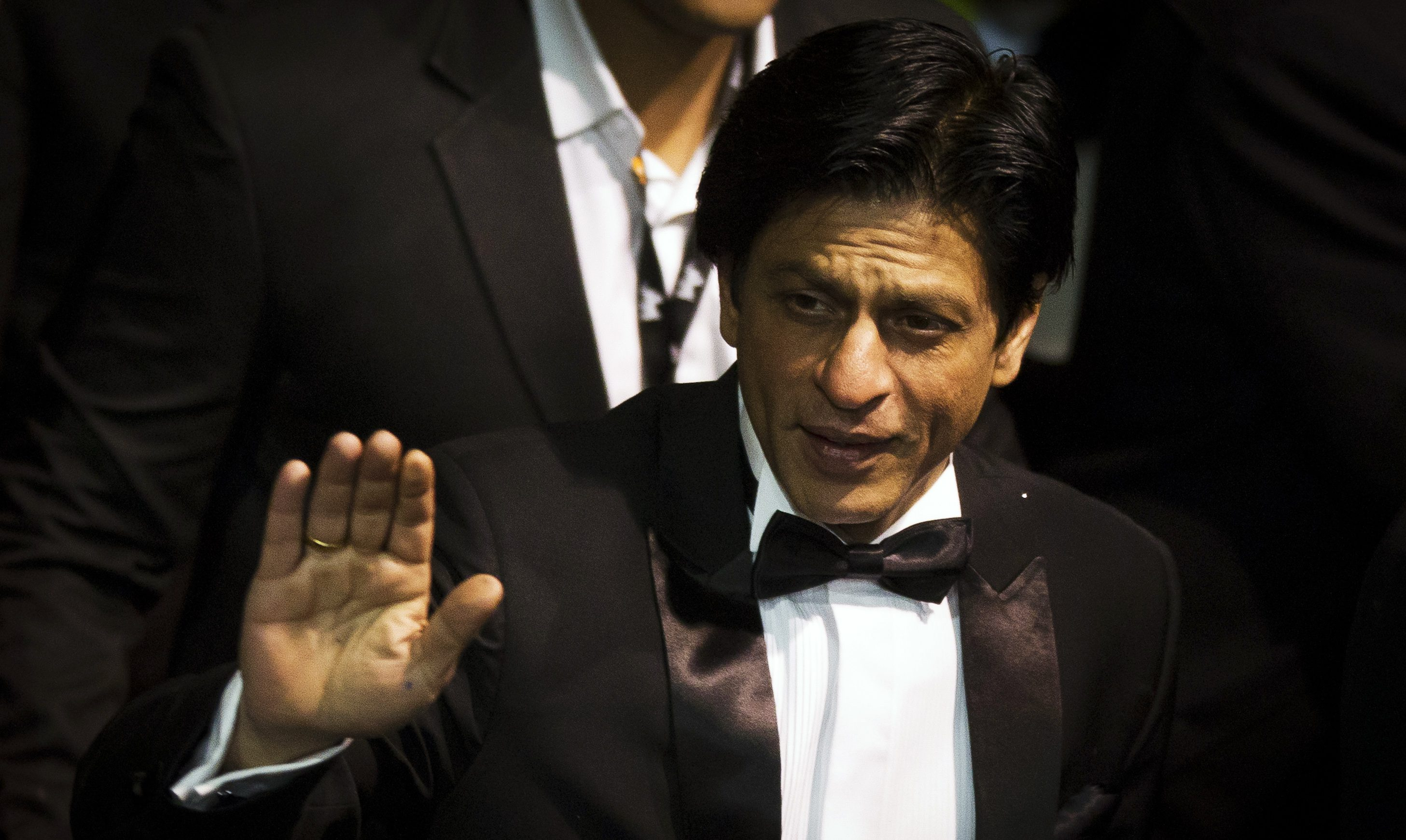 """Cast member Shah Rukh Khan arrives for the screening of the movie """"Don - The King is back"""" at the 62nd Berlinale International Film Festival in Berlin February 11, 2012. REUTERS/Thomas Peter (GERMANY  - Tags: ENTERTAINMENT) - RTR2XOQA"""