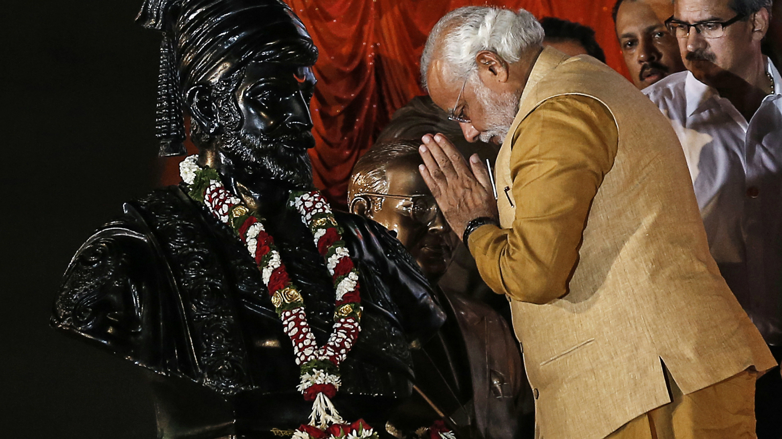 Hindu nationalist Narendra Modi, prime ministerial candidate for the main opposition Bharatiya Janata Party (BJP), gestures at the statue of Chhatrapati Shivaji, revered by many in western India as a Hindu warrior king, during an election campaign rally in Mumbai April 21, 2014. Around 815 million people have registered to vote in the world's biggest election - a number exceeding the population of Europe and a world record - and results of the mammoth exercise, which concludes on May 12, are due on May 16.