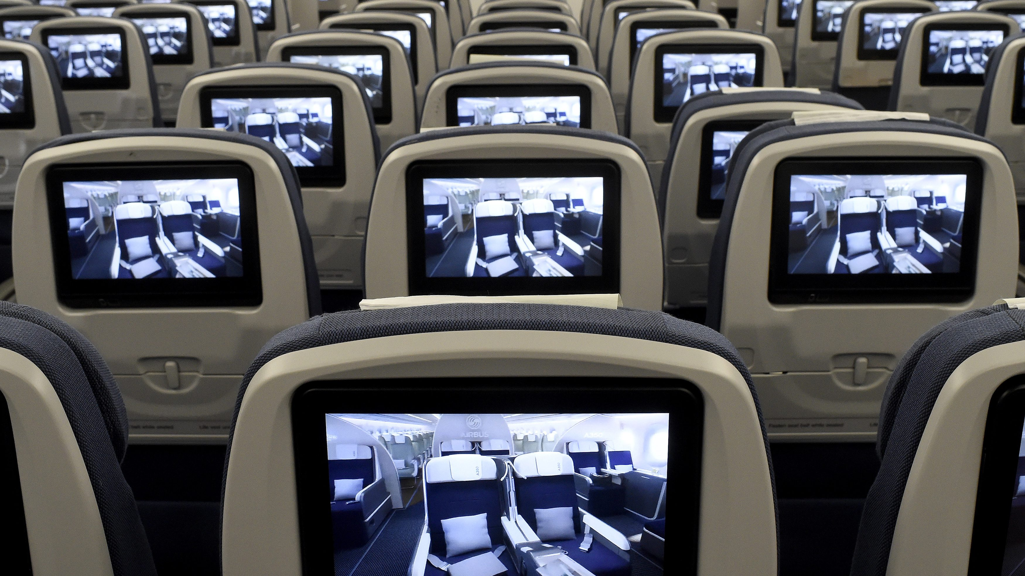 TV screens, installed on board of an Airbus A350 XWB flight-test aircraft are pictured during a media-day at the German headquarters of aircraft company Airbus in Hamburg-Finkenwerder, April 7, 2014. European planemaker Airbus unveiled on Monday the first cabin for its new mid-sized twin-engined airliner, the A350 XWB, vowing to avoid a repeat of the delays caused by cabin design changes on its bigger A380 super jumbo.